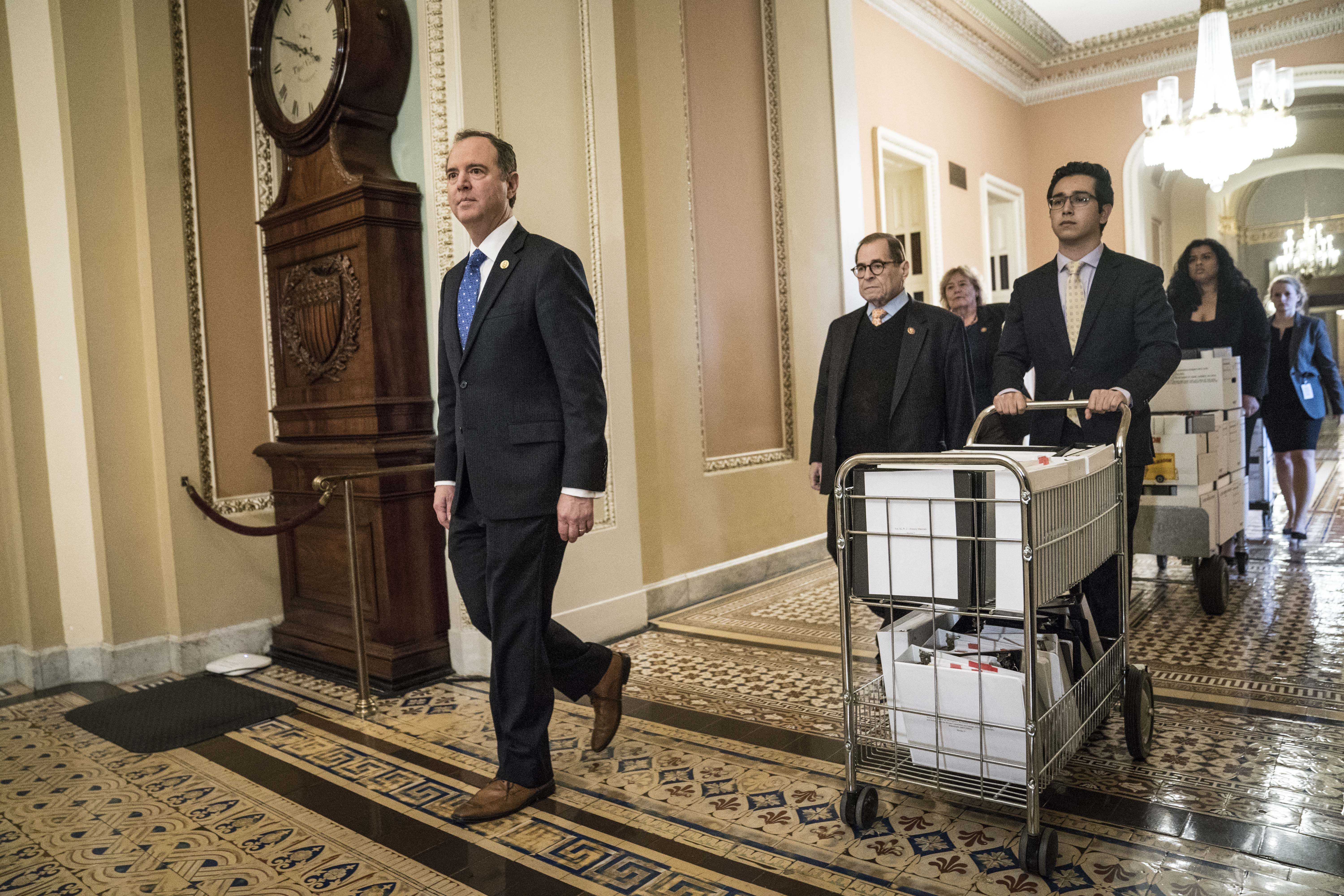House impeachment managers Representative Adam Schiff, a Democrat from California, left, Representative Jerry Nadler, a Democrat from New York, center, and Representative Zoe Lofgren, a Democrat from California, rear, deliver new documents to the Senate floor at the U.S. Capitol in Washington, D.C., U.S., on Saturday, Jan. 25, 2020. (Photo: Sarah Silbiger/Bloomberg via getty Images