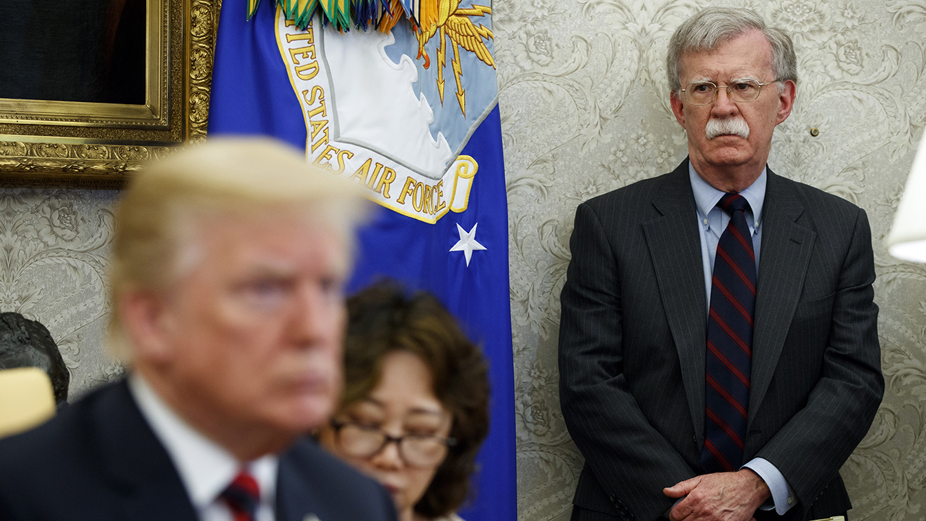 President Donald Trump meets with South Korean President Moon Jae-In in the Oval Office of the White House in 2018, in Washington, as national security adviser John Bolton watches. (Photo: Evan Vucci/AP)