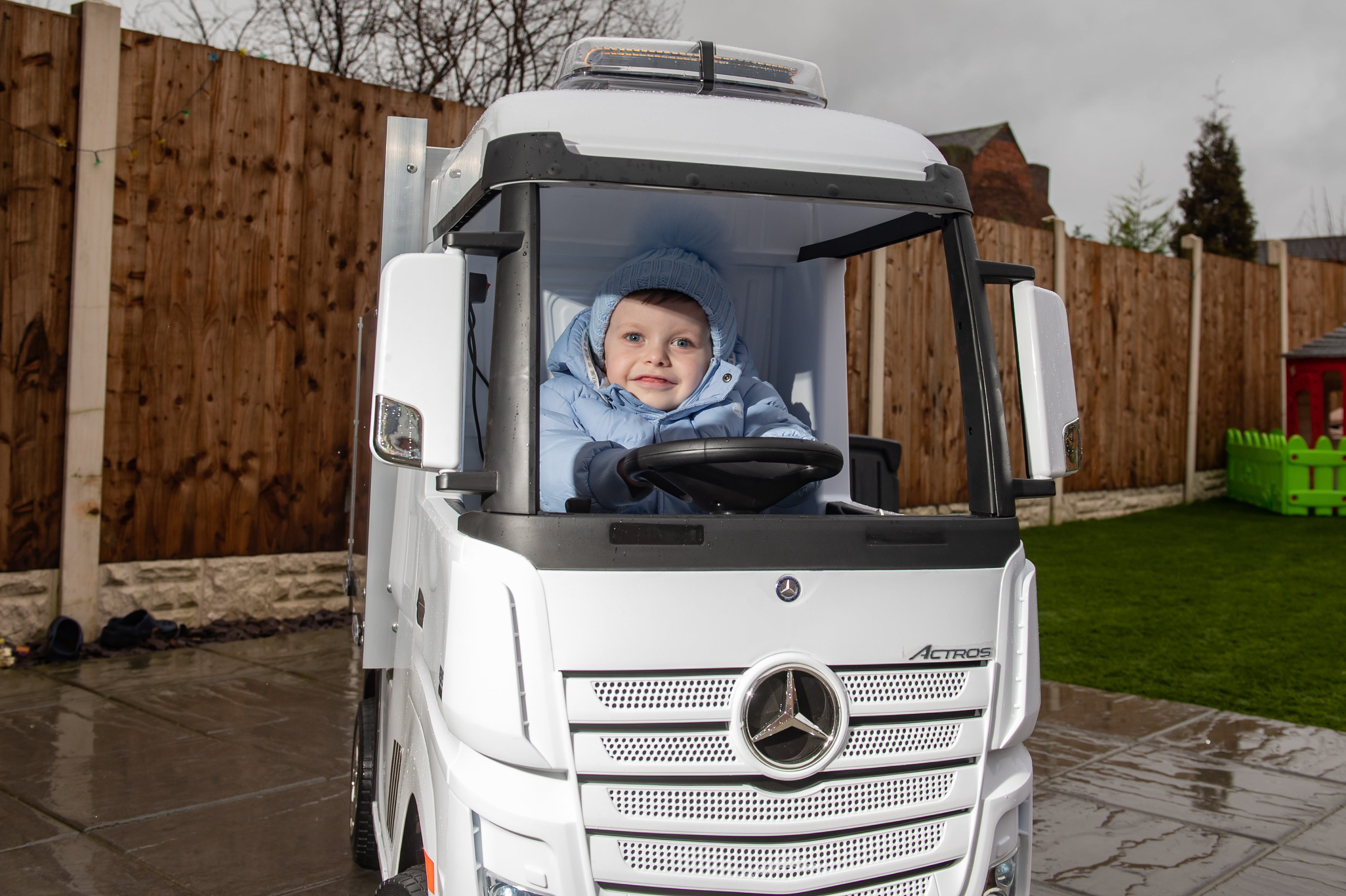 Little Hugene Wilkes, 4, loves nothing more than travelling around his local park in the impressive toy, which has a top speed of 5mph and a battery life of over an hour. (SWNS)