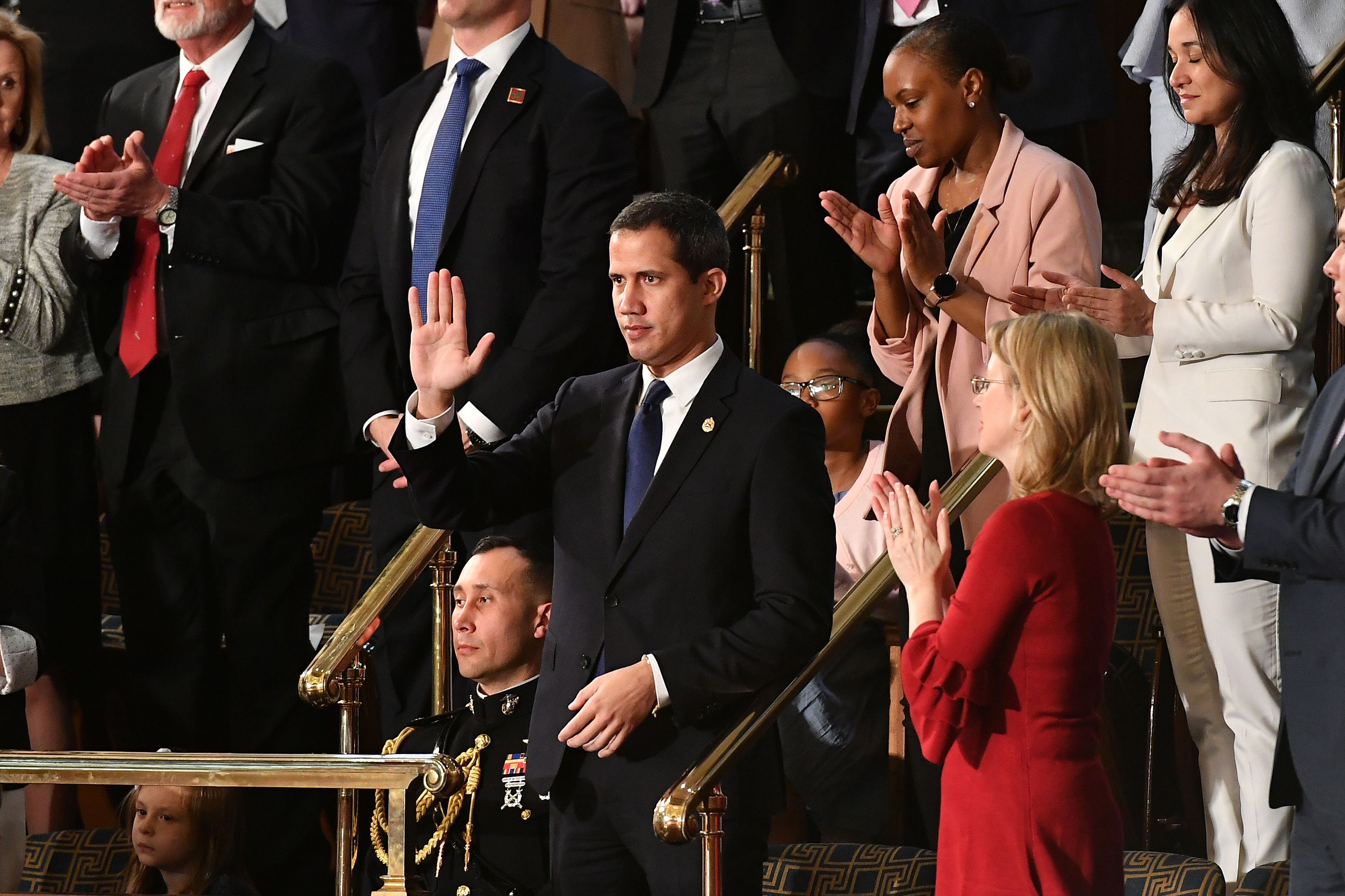 Venezuelan opposition leader Juan Guaido (C) waves as he is acknowledged by US President Donald Trump during his the State of the Union address at the US Capitol in Washington, DC, on February 4, 2020. (Mandel Ngan/AFP via Getty Images)