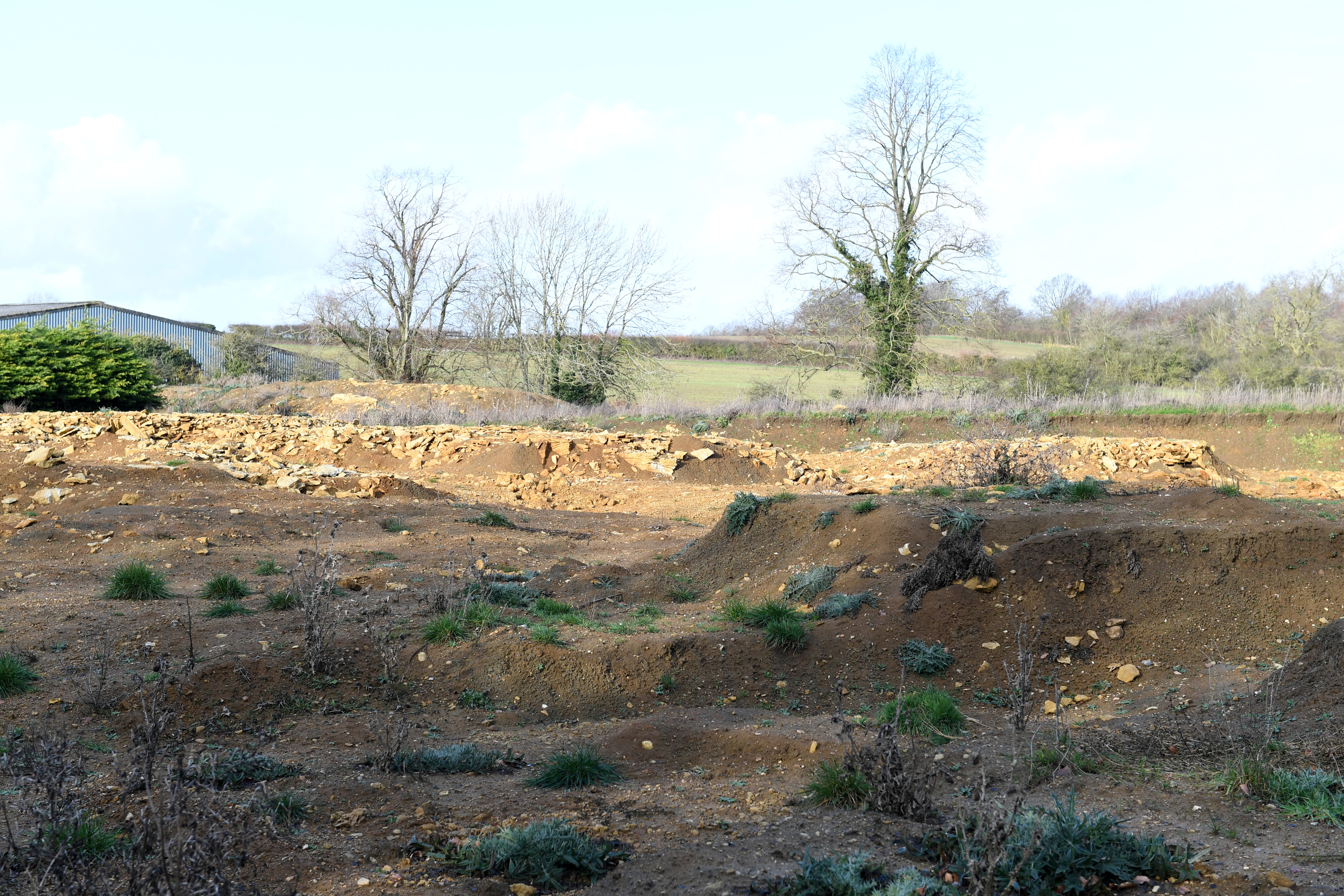 The site in Buckingham, Bucks where remains of 40 bodies including some with their hands tied behind their backs have been found buried in shallow graves. See SWNS copy SWCAskeletons: The grisly remains of 40 bodies including some with their hands tied behind their backs have been found buried in shallow graves on a building site. The shocking discovery of 42 skeletons was made during ground works for a new development of 72 retirement flats on former farmland in Buckingham, Bucks. It is thought the skeletons could date from Anglo Saxon times or from during the English Civil War or possibly even criminals who were hanged on the gallows.