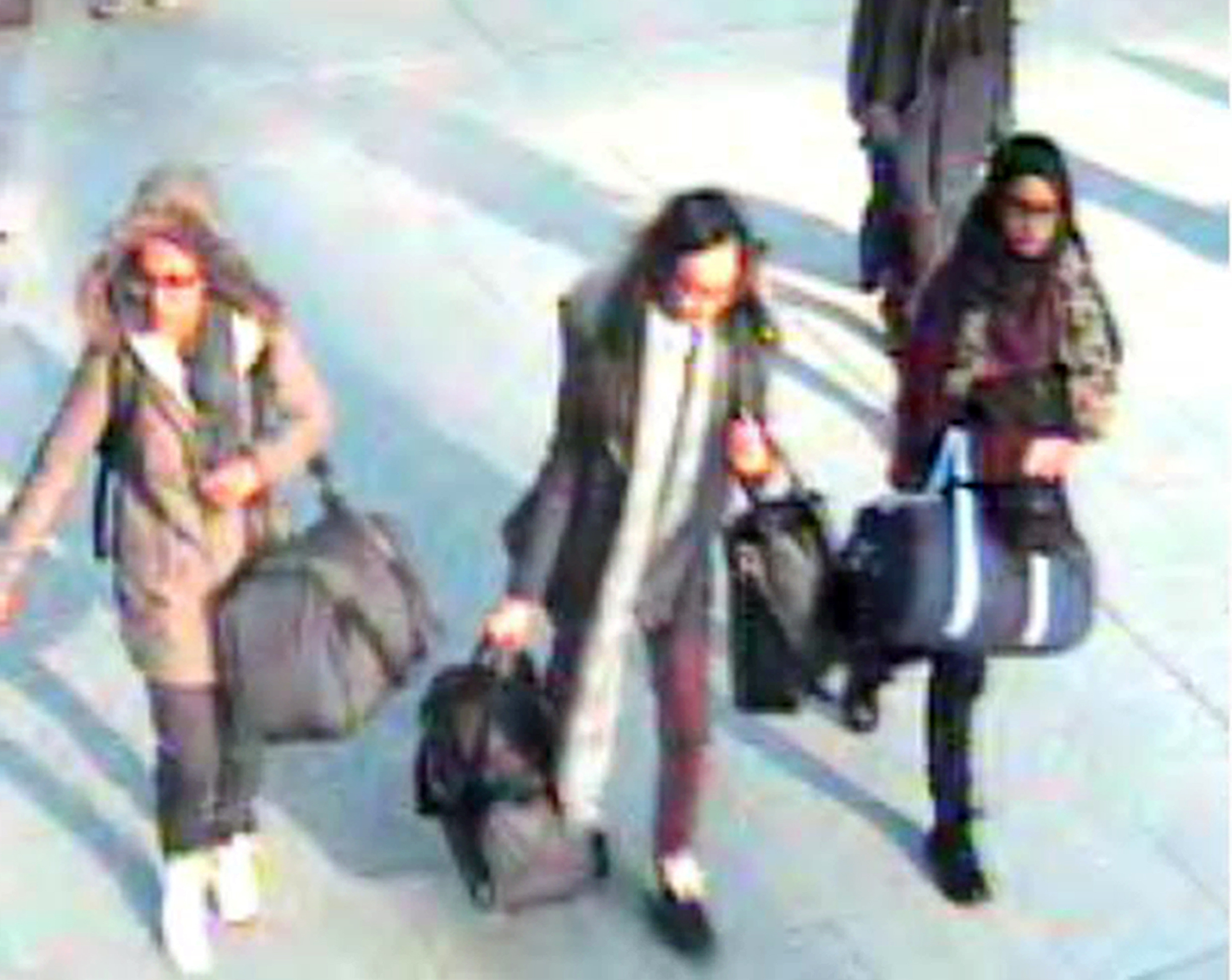Handout still taken from CCTV issued by the Metropolitan Police of (left to right) 15-year-old Amira Abase, Kadiza Sultana,16 and Shamima Begum,15 at Gatwick airport, before they caught their flight to Turkey on Tuesday. The three schoolgirls believed to have fled to Syria to join Islamic State. PRESS ASSOCIATION Photo. Issue date: Sunday February 22, 2015. See PA story POLICE Syria. Photo credit should read: Metropolitan Police/PA Wire  NOTE TO EDITORS: This handout photo may only be used in for editorial reporting purposes for the contemporaneous illustration of events, things or the people in the image or facts mentioned in the caption. Reuse of the picture may require further permission from the copyright holder.