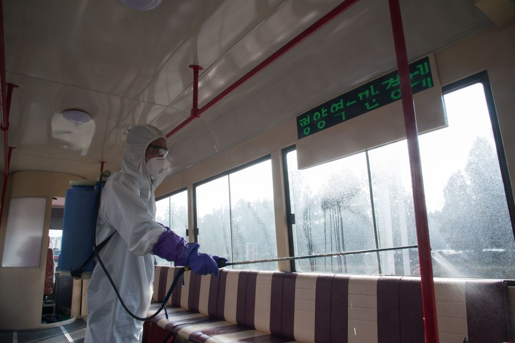 An official from the anti-epidemic headquarters disinfects a tramcar amid the coronavirus outbreak.