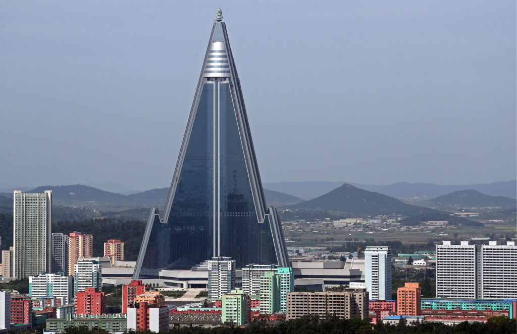 The Ryugyong Hotel skyscraper pictured in Pyongyang against a blue sky. Source: Getty