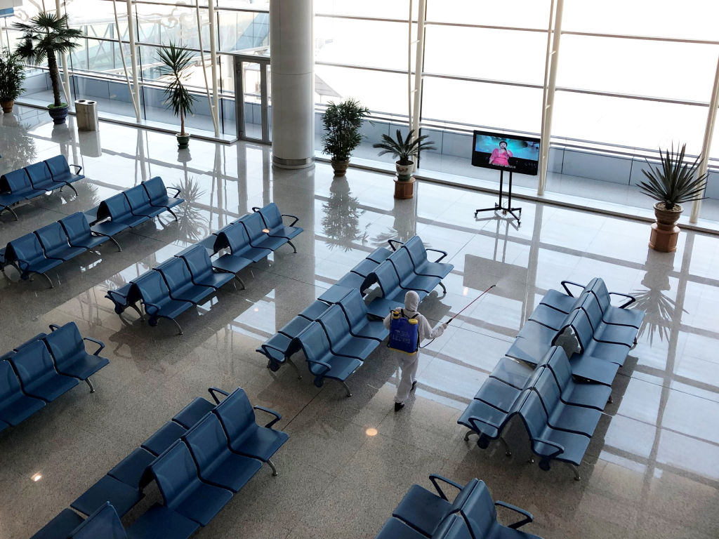 Pictured is an employee disinfecting public spaces at Pyongyang International Airport amid the coronavirus outbreak.