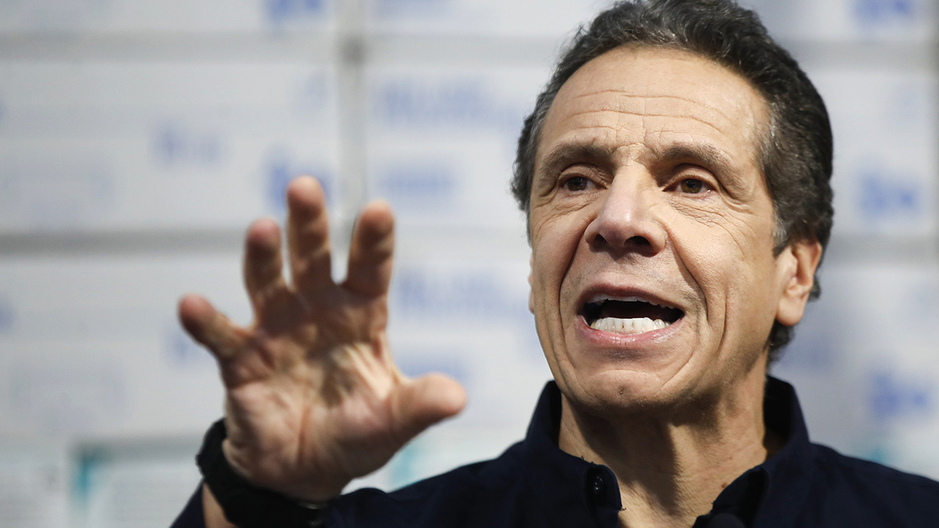 New York Gov. Andrew Cuomo speaks during a news conference against a backdrop of medical supplies at the Jacob Javits Center that will house a temporary hospital in response to the COVID-19 outbreak, Tuesday, March 24, 2020, in New York. (John Minchillo/AP)