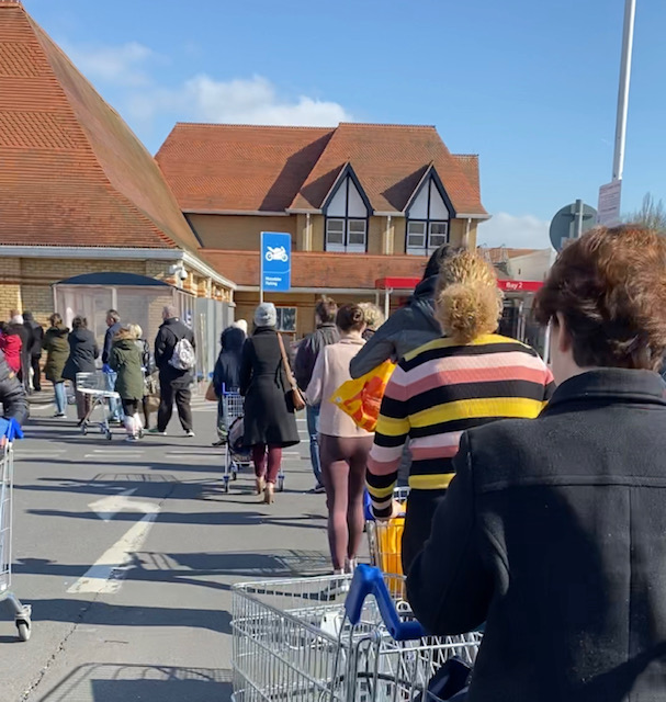 NHS workers queue before their special designated shopping hour at 10am local time at Tesco in Purley, Surrey. Photo: Yahoo Finance UK/Lianna Brinded