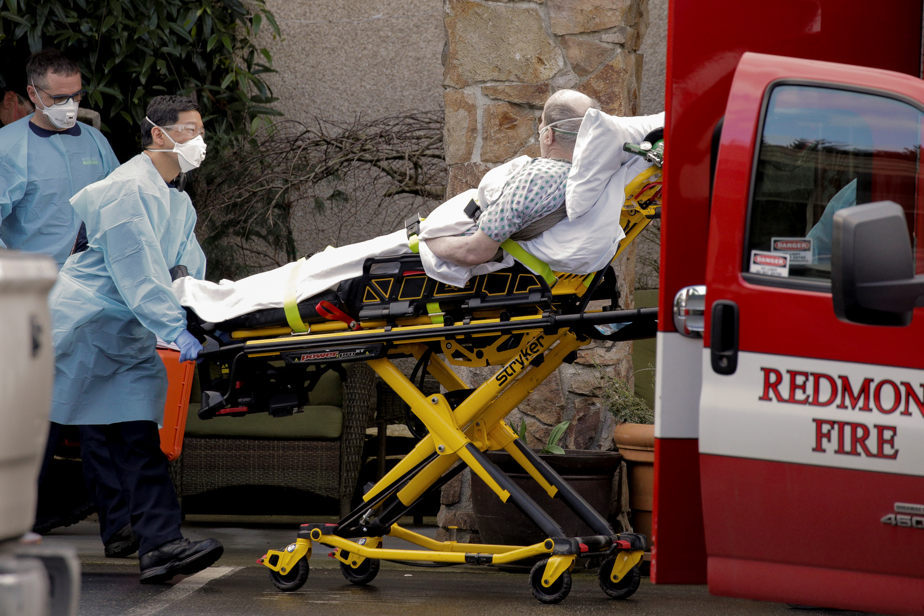 Medics transport a man on a stretcher into an ambulance at the Life Care Center, a long-term care facility linked to several confirmed coronavirus cases, in Kirkland, Washington, on  March 3, 2020. (David Ryder/Reuters)