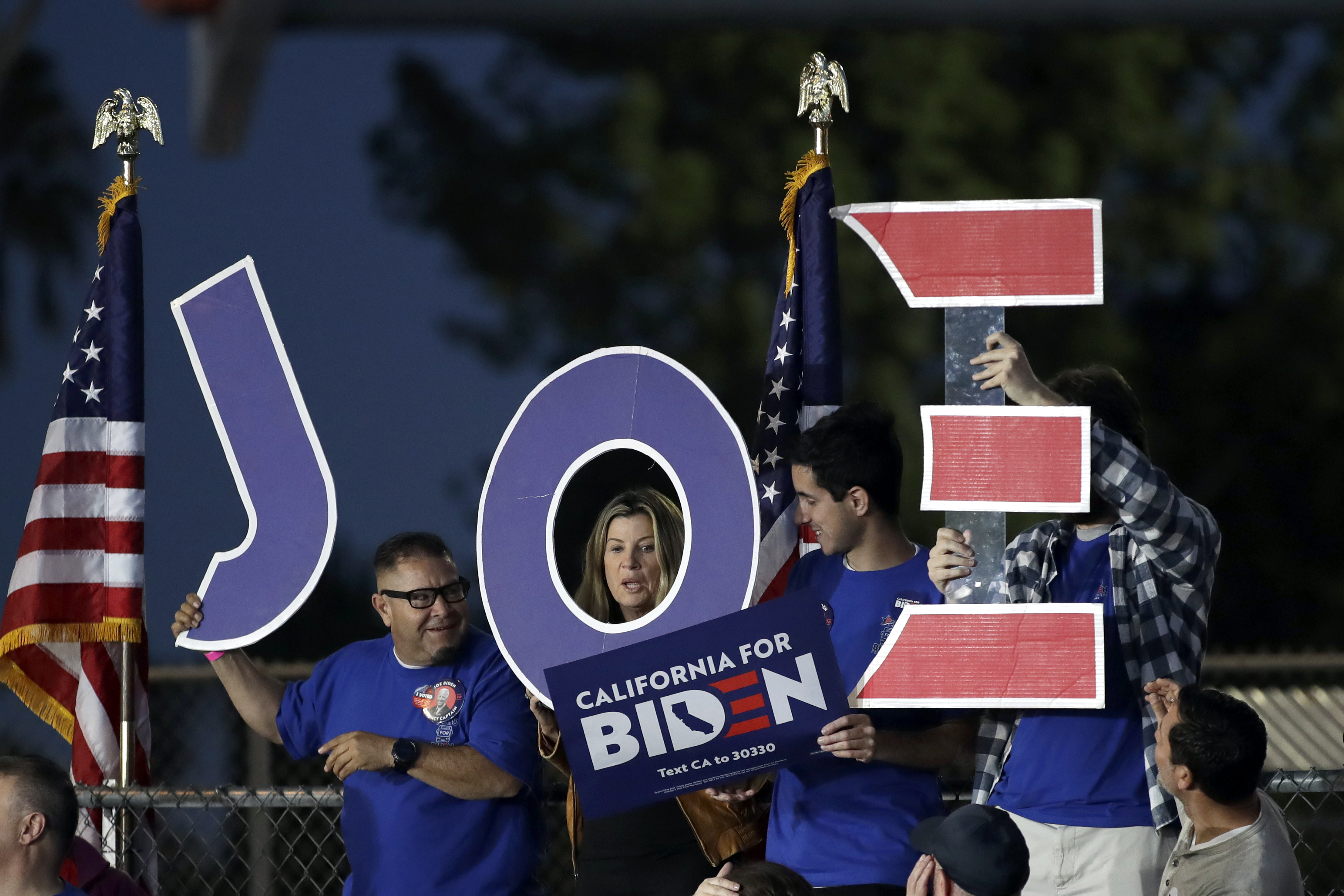 Supporters hold a sign before a campaign rally for Democratic presidential candidate former Vice President Joe Biden on March 3, 2020, in Los Angeles. (Marcio Jose Sanchez/AP)