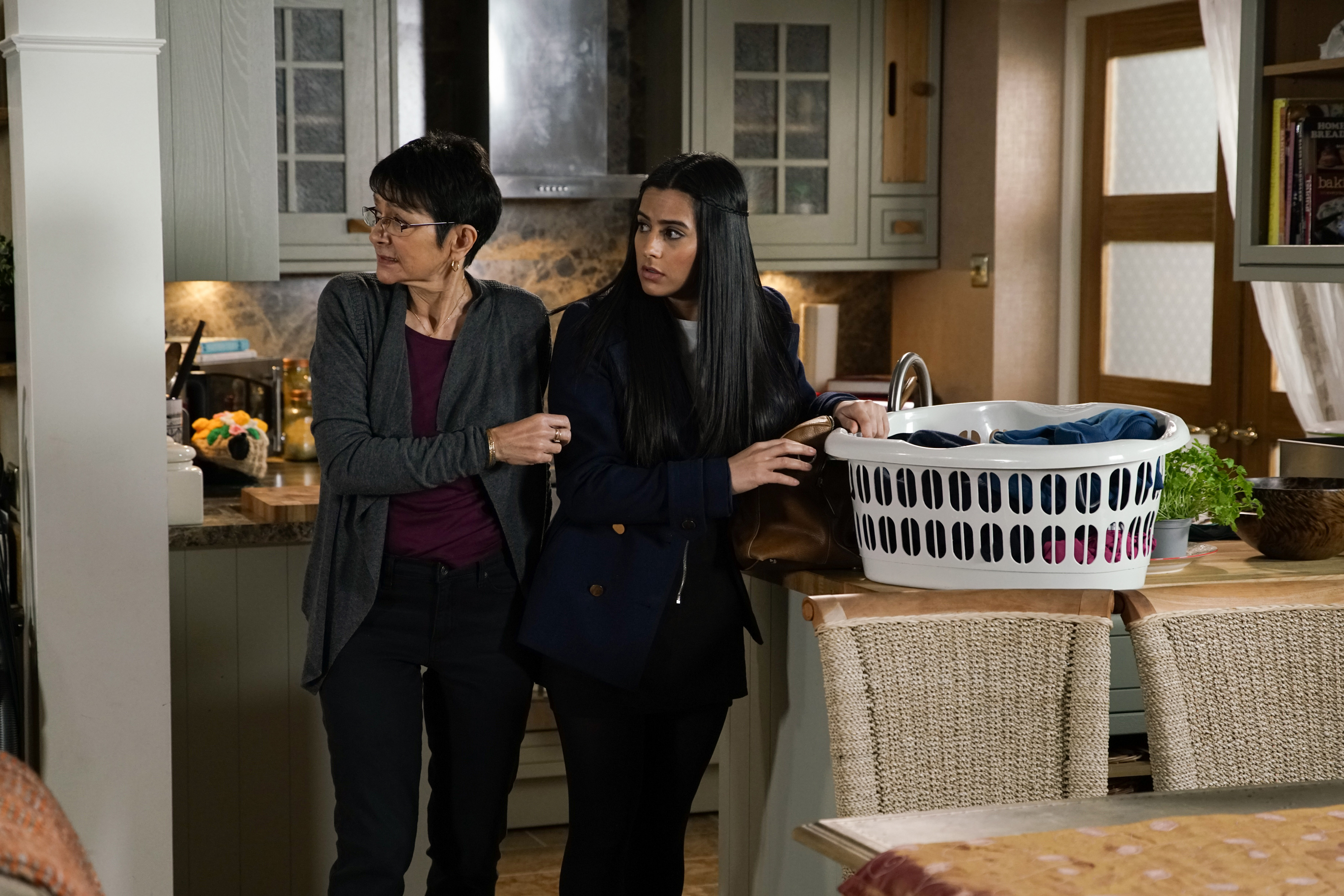 When Yasmeen Metcalfe [SHELLEY KING] reveals that they're moving to Cyprus, Alya's horrified and tells Yasmeen that it's clear Geoff is abusing her and trying to separate her from the people who care about her. Determined to rescue her Gran from the clutches of Geoff, Alya grabs some of Yasmeen's clothes and starts stuffing them into a bag,  (ITV Plc)