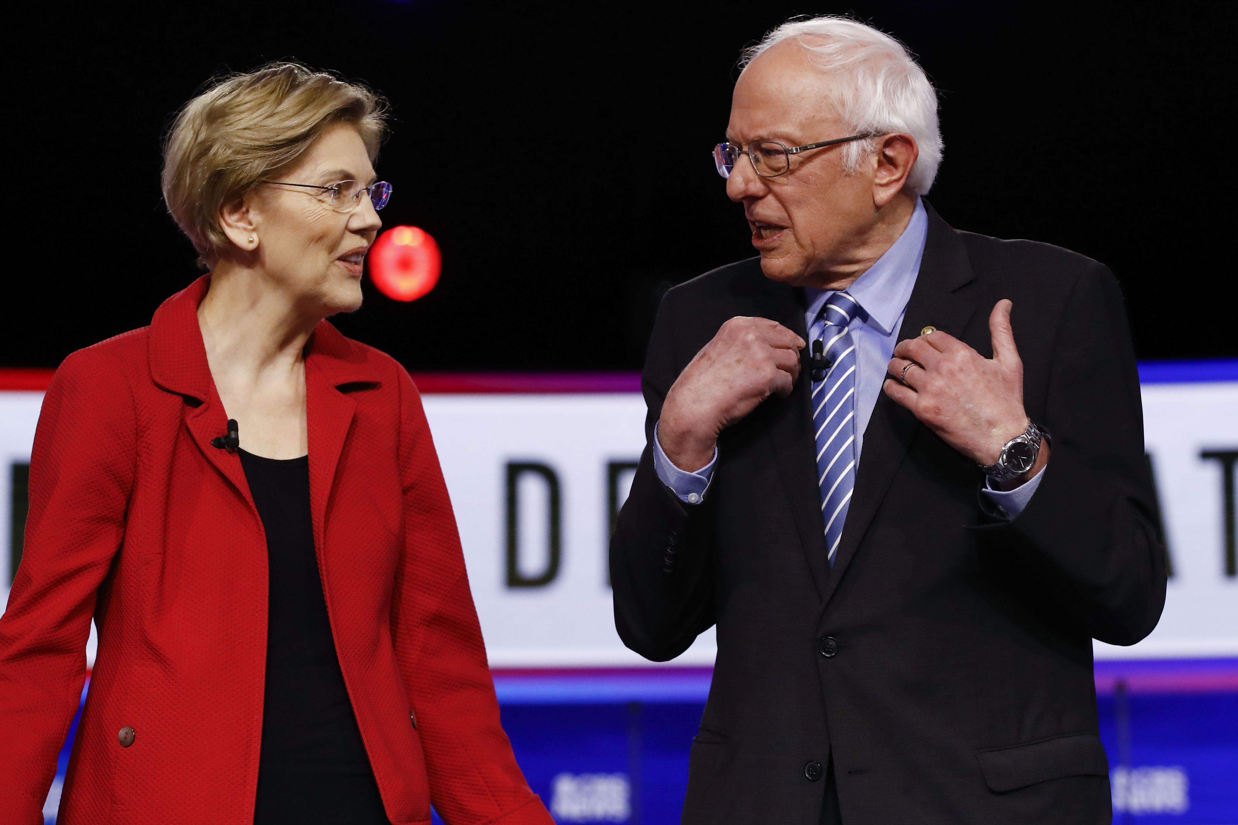 Sen. Elizabeth Warren, D-Mass., and Sen. Bernie Sanders, I-Vt., former Vice President Joe Biden, participate in a Democratic presidential primary debate on Feb. 25, 2020, in Charleston, S.C. (Matt Rourke/AP)