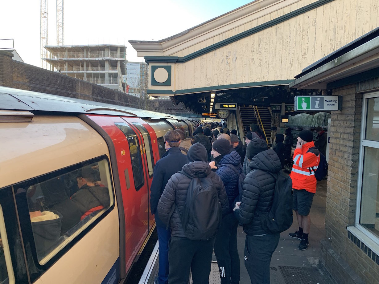 Commuters struggle to get on an already packed Northern Line train at Colindale Station in north London on Monday (@kubson84/Twitter)
