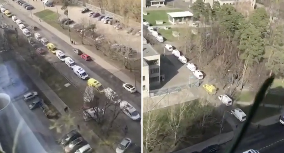 Ambulances are pictured stationary, crowding a block, in Moscow.