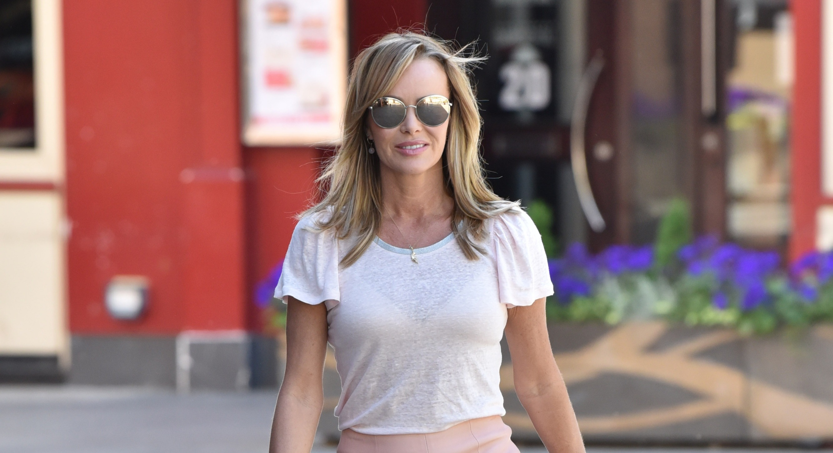 Amanda Holden slipped on a designer outfit to present her radio show this morning (Getty Images)