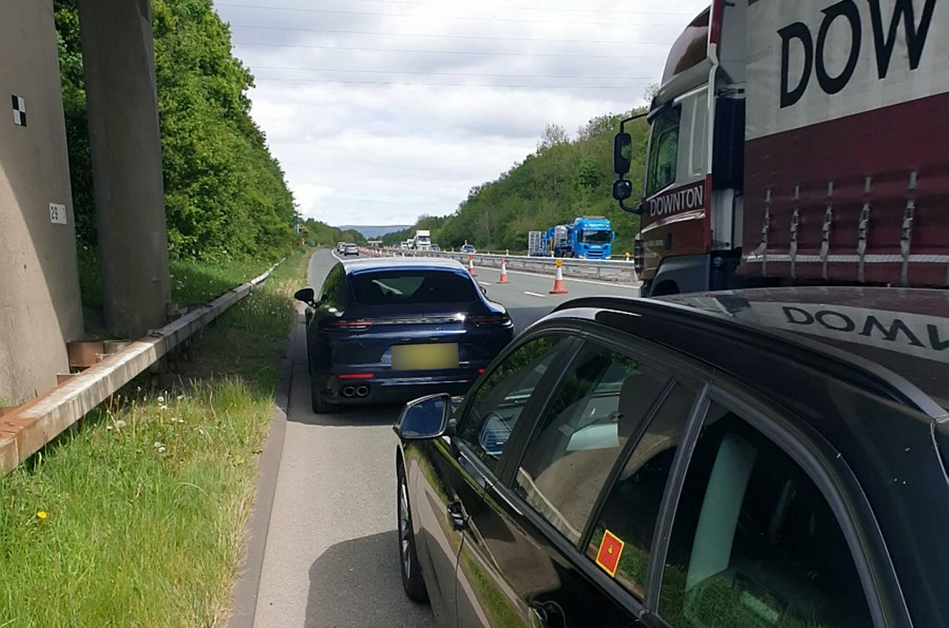 """A """"disgraceful"""" Porsche driver was caught speeding past a police car at 144mph - almost triple the speed limit.  See SWLEporsche.  The motorist, who hasn't been named, was clocked while driving through 50mph zone roadworks on the M65 on Monday (May 11).  The officer followed the driver for nine miles between Blackburn and Burnley, Lancs.  Posting on Twitter, the road cop said: """"The driver of this Porsche overtook my police car on the M65 at 125mph. """"Speeds reached 144mph as he entered the 50mph roadworks section. Disgraceful speed.  """"He has been reported and his day in court awaits. The roads aren't a race track no matter what you drive."""""""