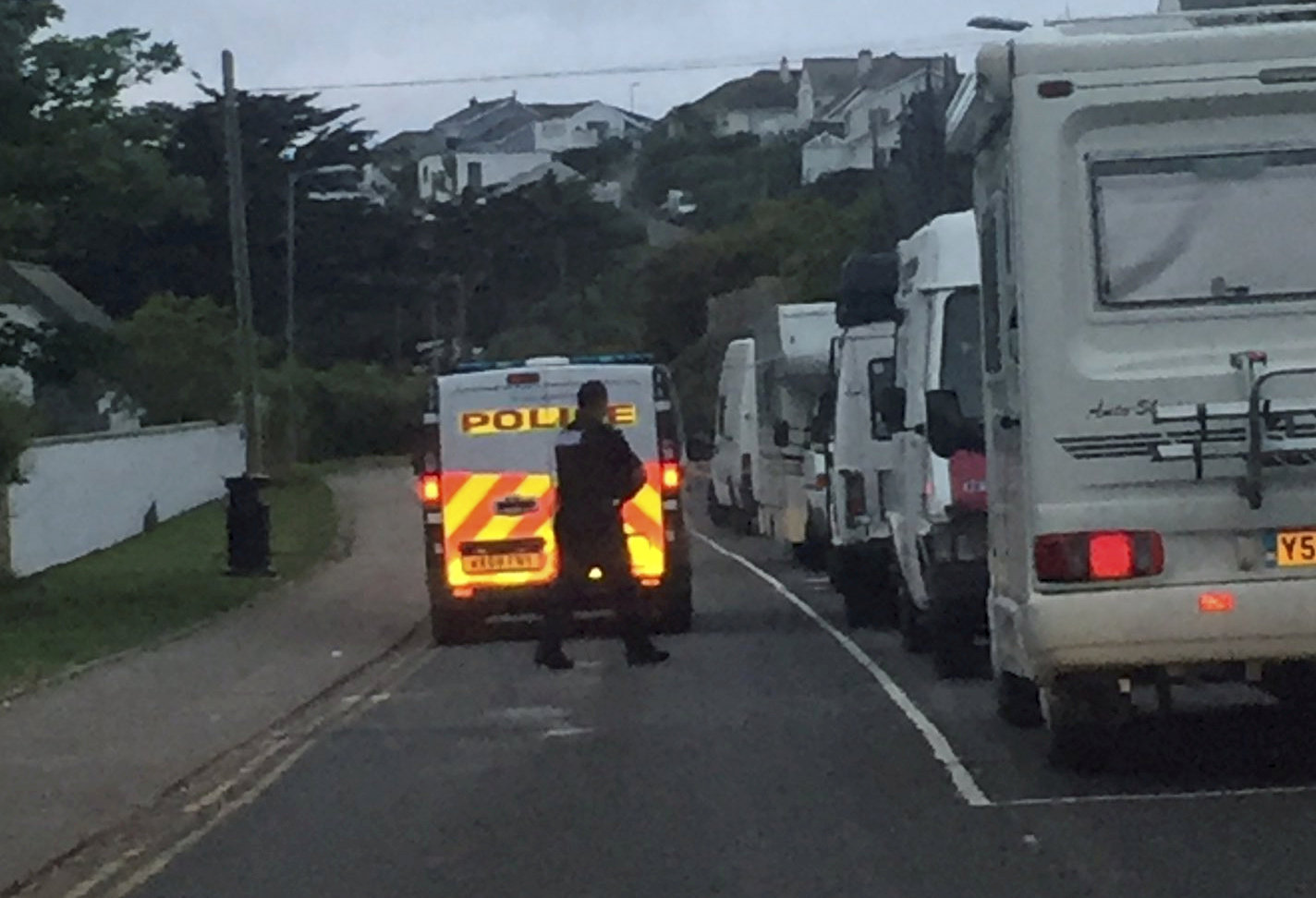 Police gave people who had camped in Newquay, Cornwall, an early morning wake-up call. (Picture: SWNS)