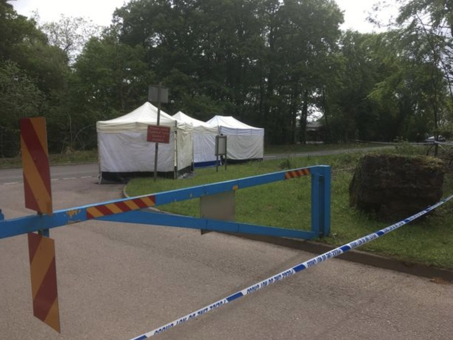 Tents erected at the scene where body parts were found in two suitcases. Source: BPM Media