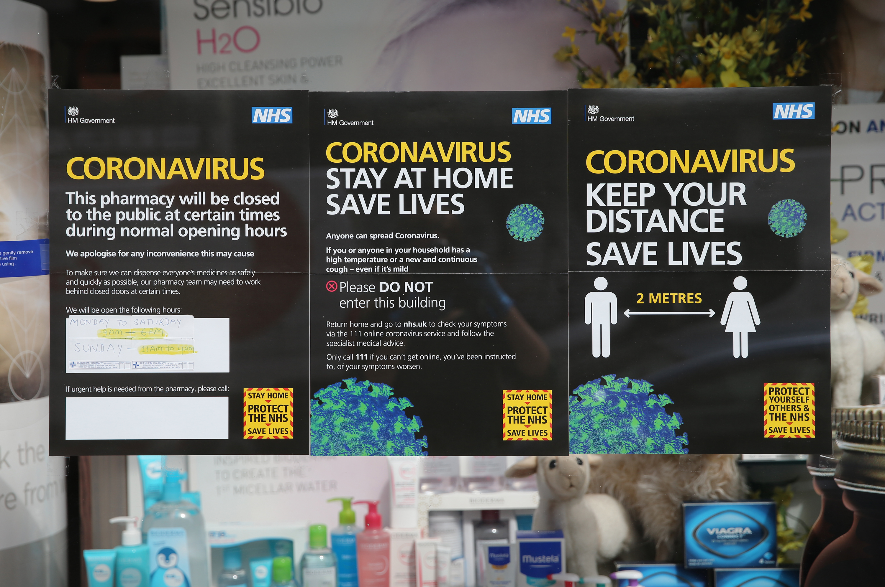 NHS information signs on covid-19 are displayed outside a pharmacy in Portobello Road, west London, as the UK continues in lockdown to help curb the spread of the coronavirus. Picture date: Sunday April 26, 2020.