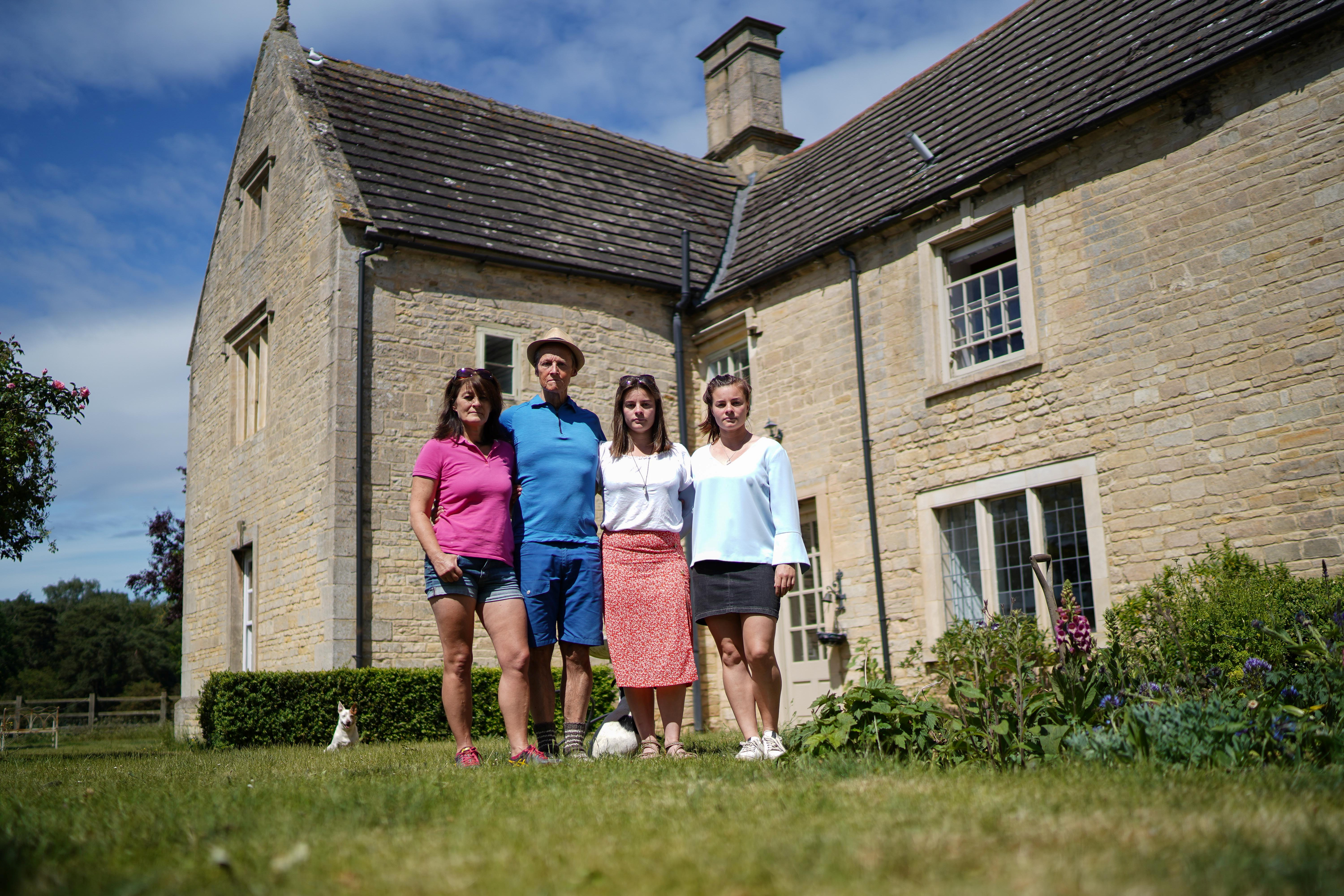 Barbara and Simon Campbell with daughters Meghan and Rosie outside their lovingly-restored grade II-listed home. (SWNS)
