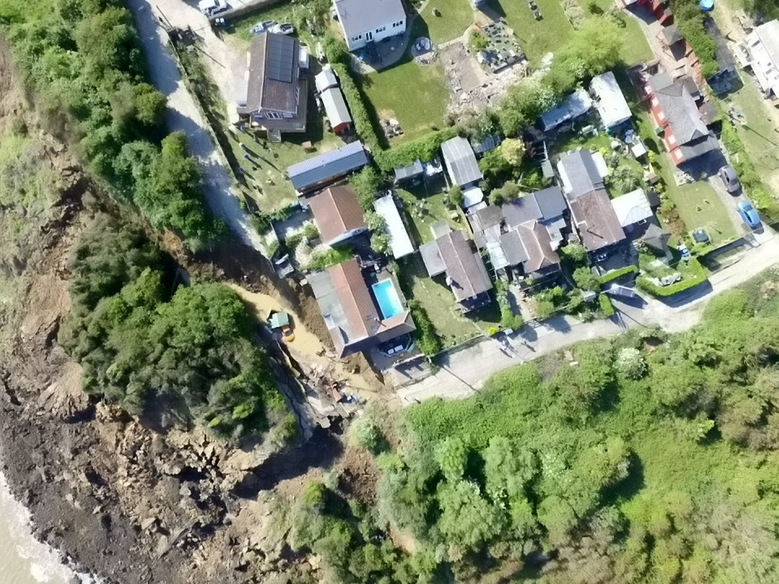 Residents were left without electricity and one person's house was in danger of falling down the cliff. (Picture: SWNS)