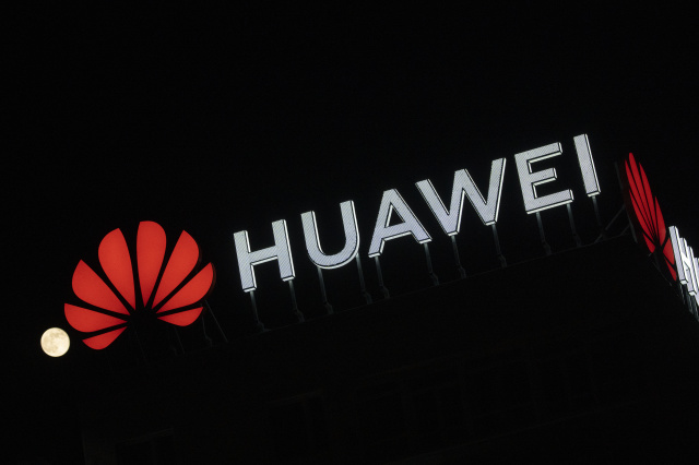 "The Huawei logo is seen atop a buildin in central Warsaw, Poland on April 8, 2020. Chinese Huawei is the largest telecommunications company in the world and the second largest mobile phone manufacturer in the world after Samsung. In January 2019 a Huawei employee in Poland had been arrested on charges of espionage at the local offices of the company in Warsaw. Huawei says it has won a quarter of all 5G contracts all around the world despite worries of security leaks involving ""backdoors"". (Photo by Jaap Arriens/NurPhoto)"