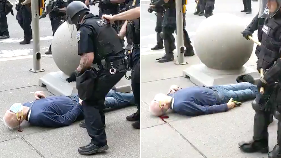 An elderly man lies on the ground bleeding from the head after being shoved by police in riot gear.