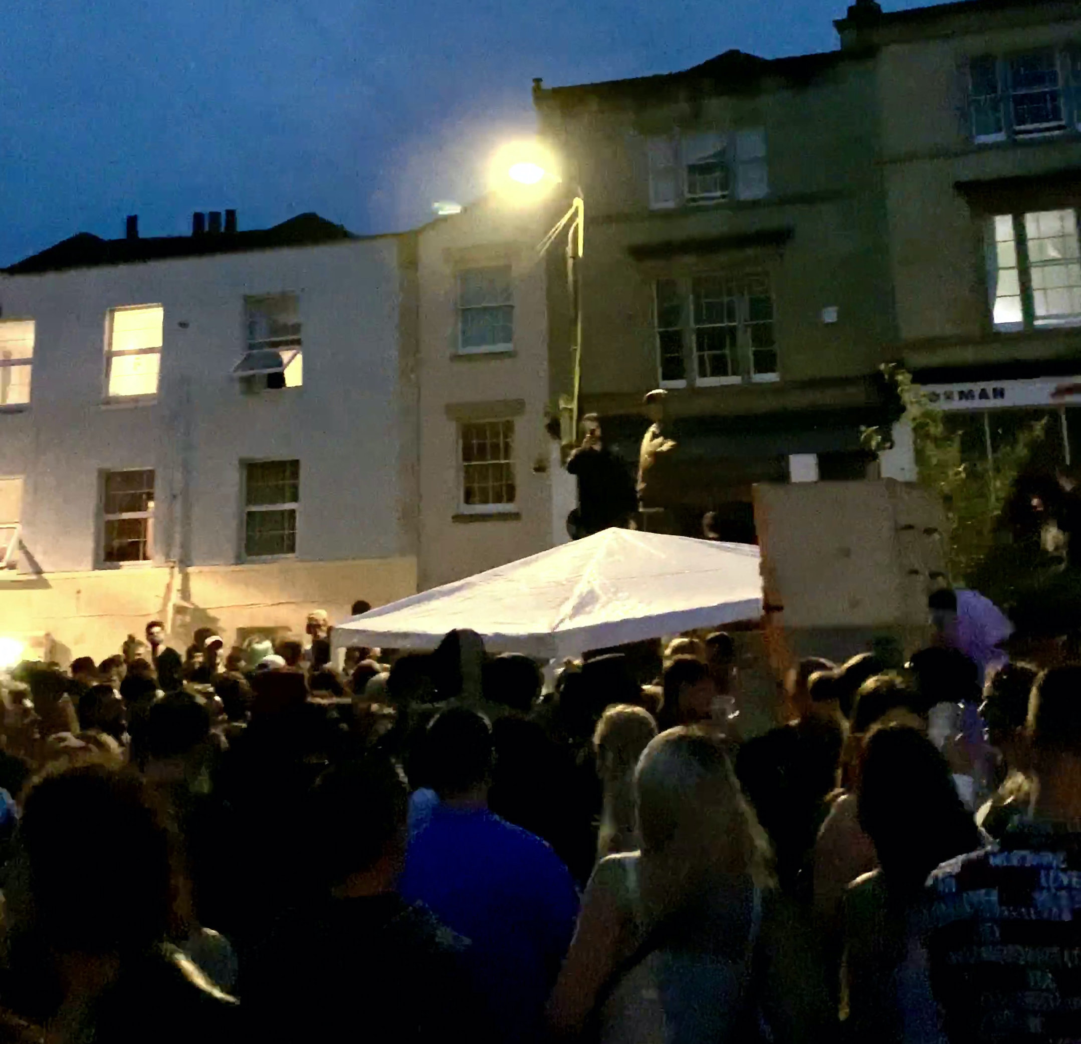 Hundreds of revellers took to a residential street in Stokes Croft, Bristol, for an all-night rave. (SWNS)