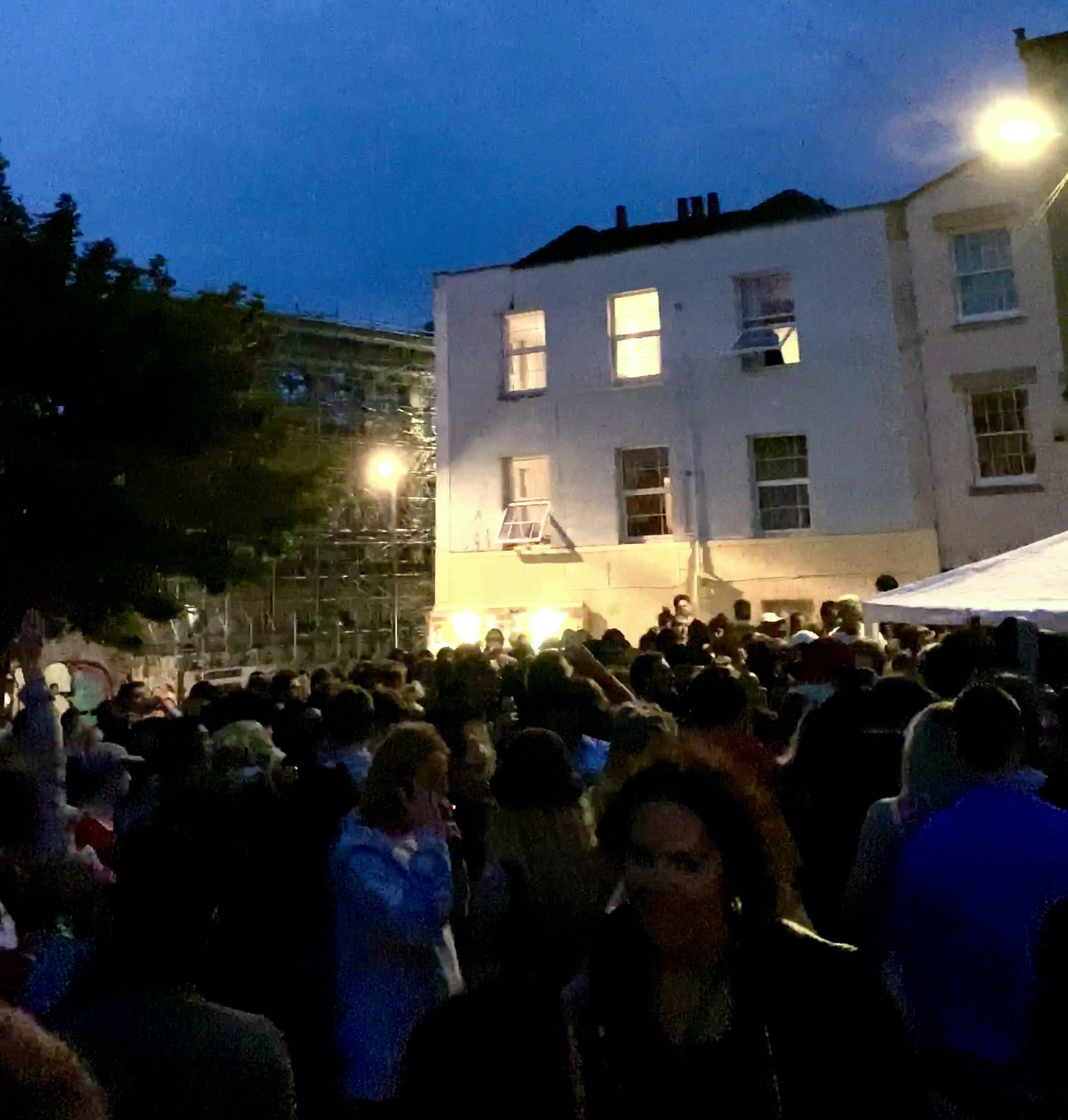 The huge crowd drank and danced the night away in front of a DJ playing dub music at the impromptu event in Stokes Croft, Bristol. (SWNS)