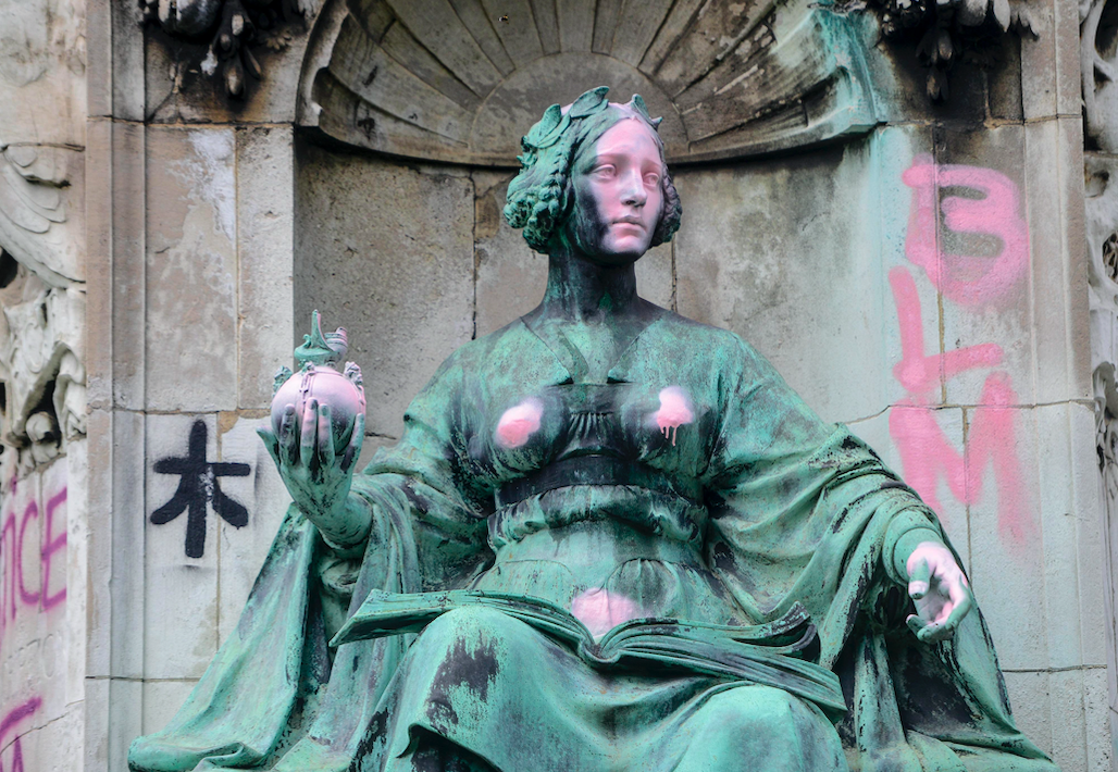 The Queen Victoria statue in Leeds was defaced with various slogans. (SWNS)