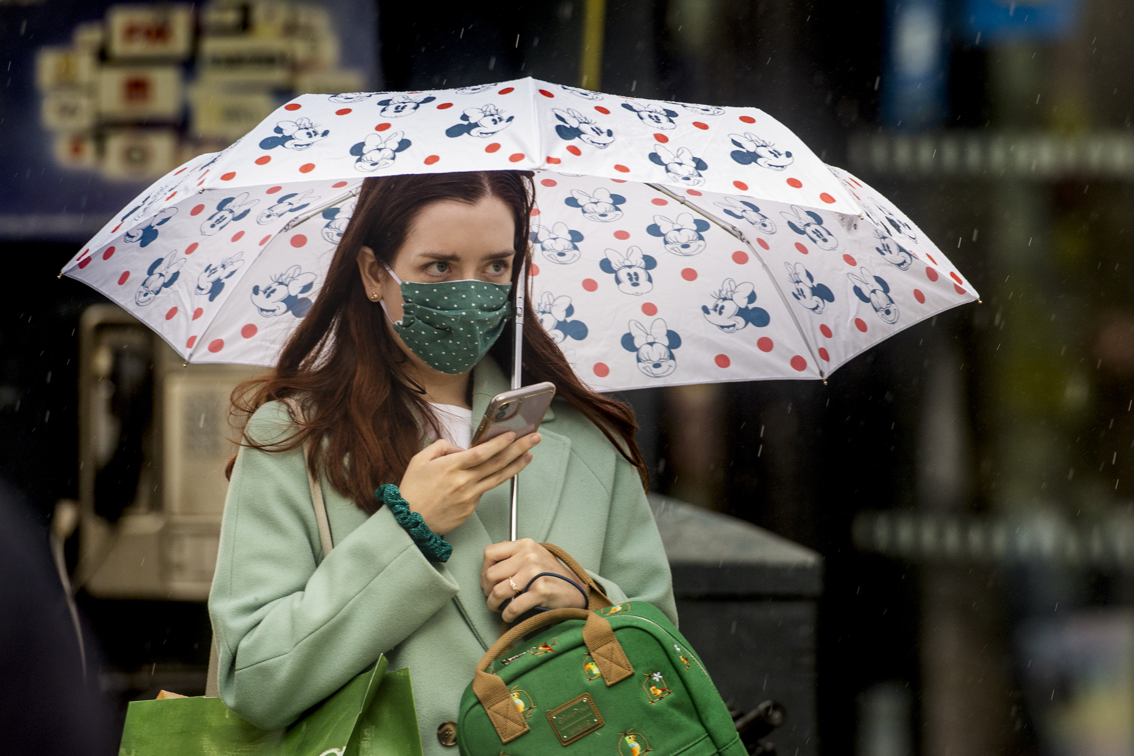 File photo dated 14/07/20 of a woman wearing a face mask. Face coverings will be mandatory in shops and supermarkets from Friday.