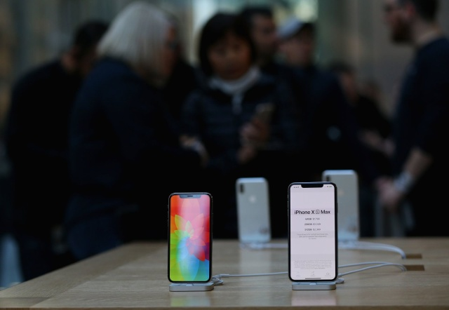 Crowds wait in anticipation for the Australian release of the latest iPhone models at Apple Store on September 21, 2018 in Sydney, Australia. Apple's latest iPhone Xs and Xs Max features super retina displays with a faster dual camera with photo and video features and the first 7-nanometer chip in a smartphone  - the A12 Bionic chip with next-generation Neural Engine. Apple have also launched the Apple Watch Series 4 which features an improved accelerometer and gyroscope, which are able to detect hard falls, and an electrical heart rate sensor that can take an electrocardiogram (ECG) using the new ECG app.