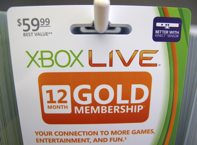 Xbox live gold membership cards are shown for sale at a Microsoft retail store in San Diego January 18, 2012. Microsoft Corp's fiscal second-quarter profit fell very slightly as lagging computer sales to cash-strapped consumers in the United States and Europe hurt its core Windows business. Picture taken January 18, 2012. REUTERS/Mike Blake (UNITED STATES - Tags: BUSINESS SCIENCE TECHNOLOGY) - GM1E81K0LOB01