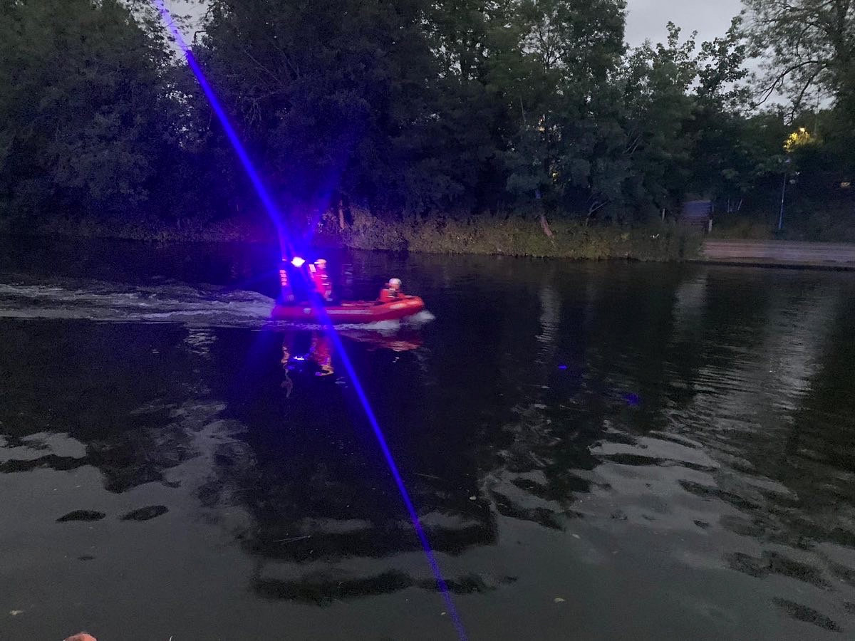 Rescue boats patrolling the river on Saturday. (SWNS)