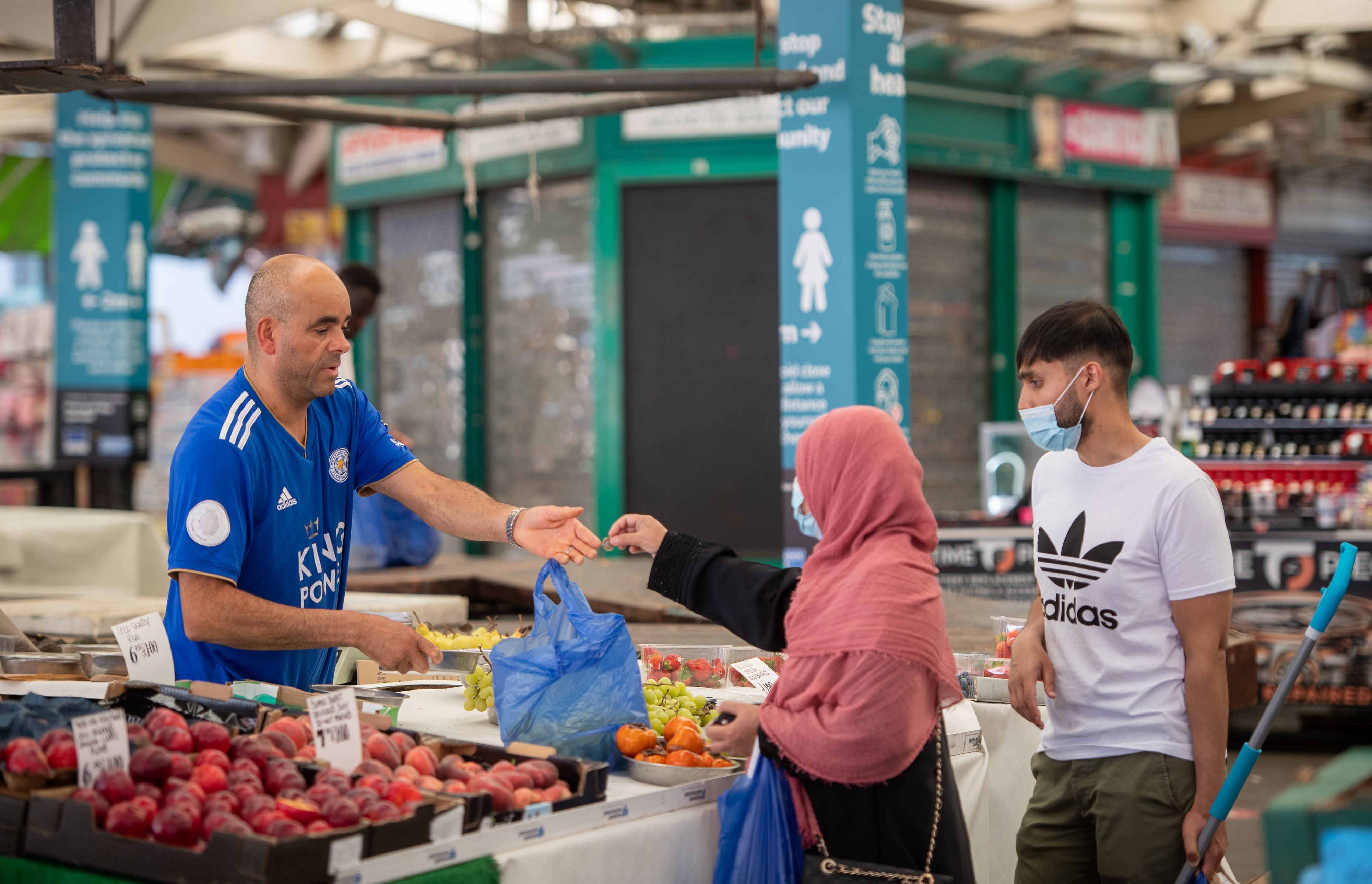 People shop at Leicester Market as a decision is due to be made on whether to lift the lockdown restrictions in the city. (Photo by Joe Giddens/PA Images via Getty Images)