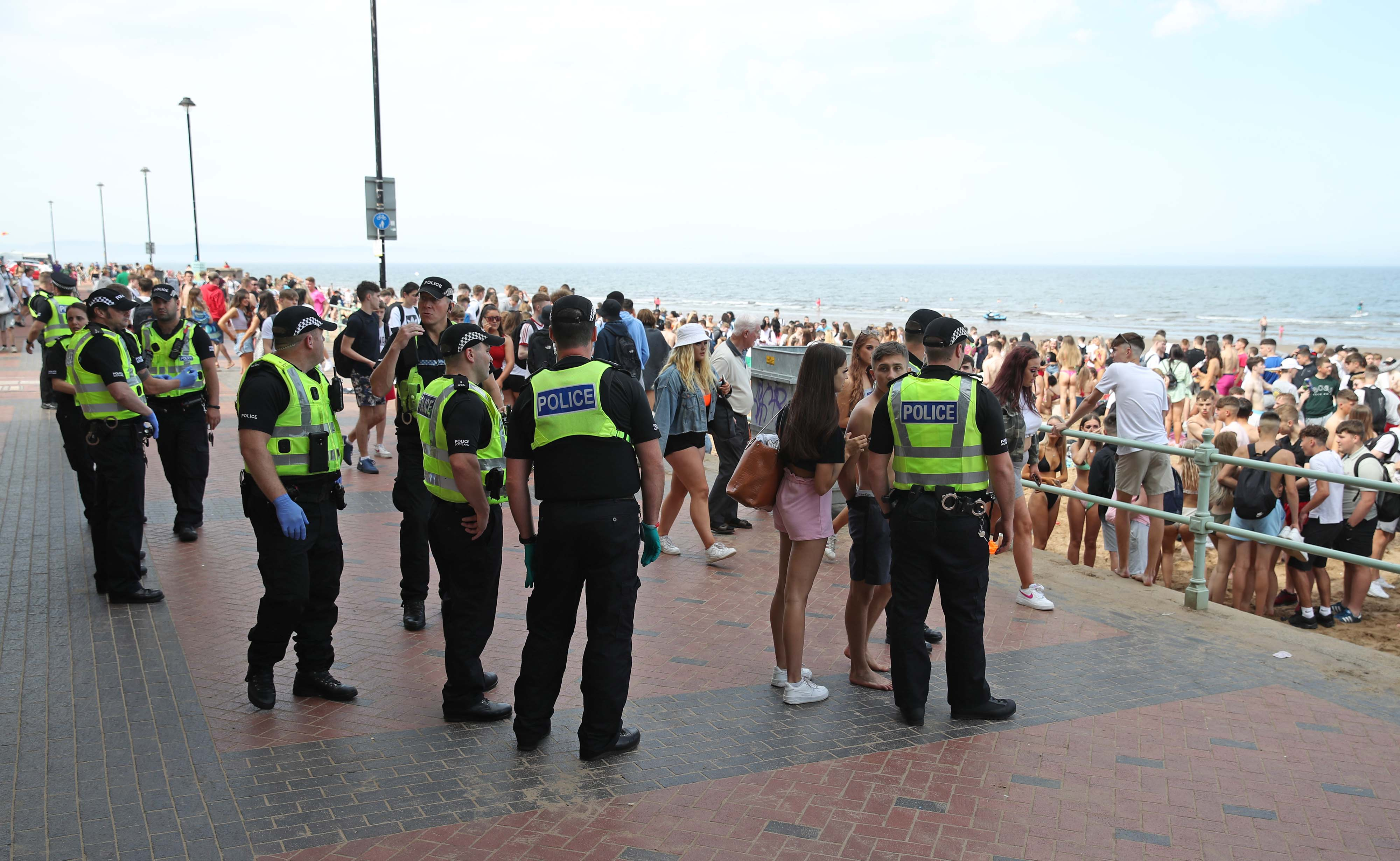 Police at Portobello Beach in Edinburgh where they broke up large crowds who flocked to the beach to make the most of the good weather.