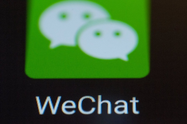 A WeChat messaging app logo is seen on an Android portable device on February 5, 2018. WeChat is one of the most popular messaging apps in China. (Photo by Jaap Arriens/NurPhoto)