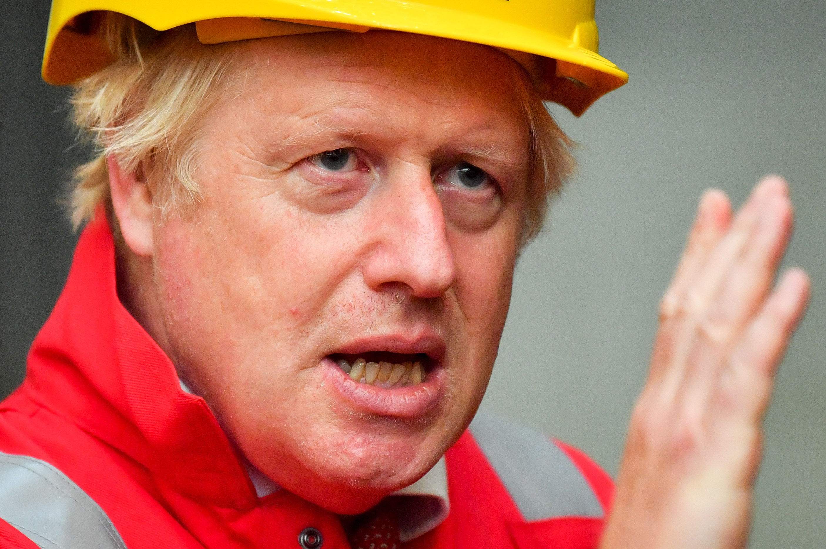 Britain's Prime Minister Boris Johnson gestures during his visit to Appledore Shipyard in south west England on August 25, 2020, as the historic shipyard announced it's re-opening having being bought by InfraStrata in a £7 million deal. (Photo by Ben Birchall / POOL / AFP) (Photo by BEN BIRCHALL/POOL/AFP via Getty Images)