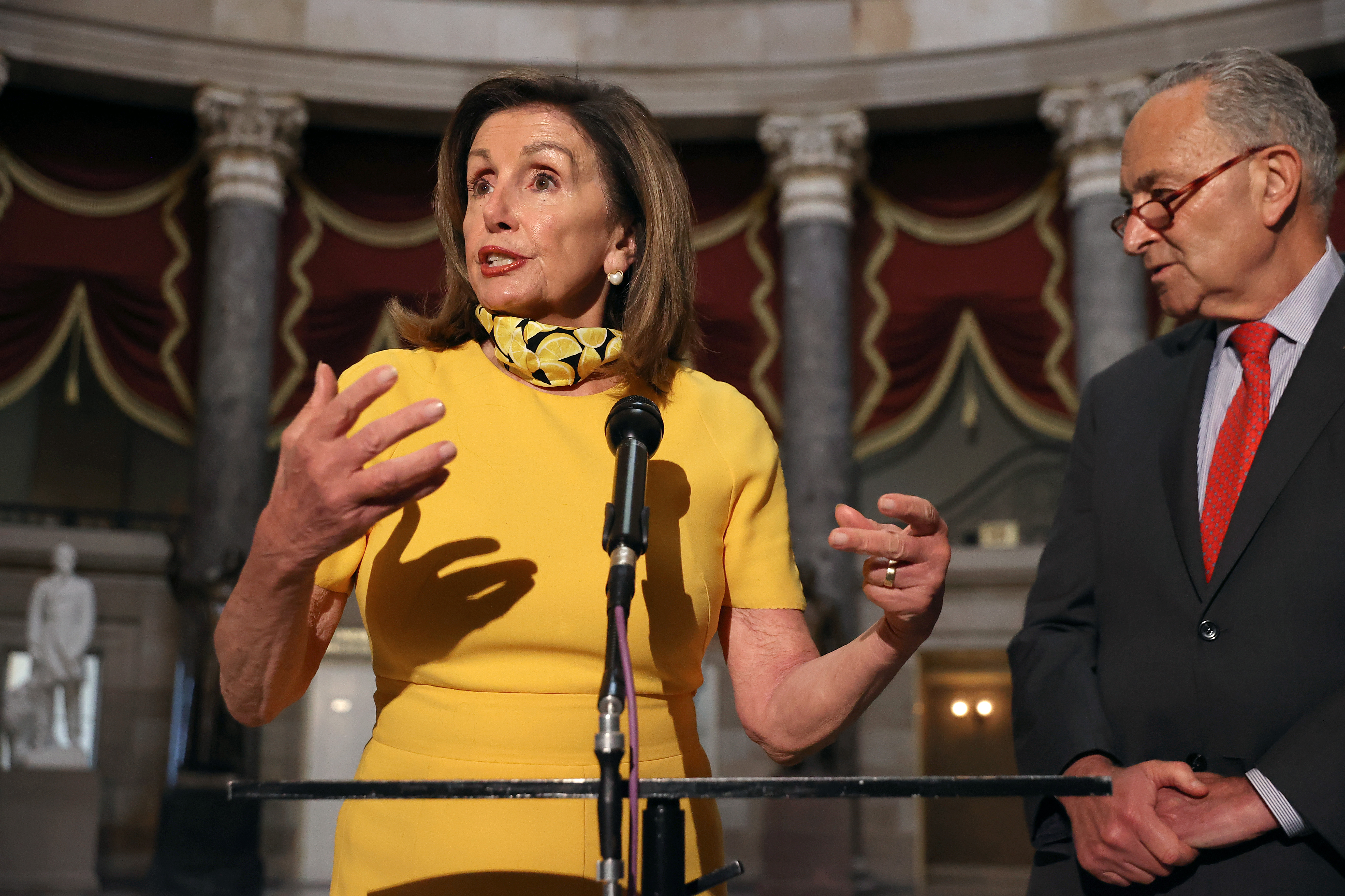 WASHINGTON, DC - AUGUST 03: Speaker of the House Nancy Pelosi (D-CA) and Senate Minority Leader Charles Schumer (D-NY) talk with reporters in Statuary Hall in the U.S. Capitol August 03, 2020 in Washington, DC. Negotiations between Pelosi, Schumer, White House Chief of Staff Mark Meadows and Treasury Secretary Steven Mnuchin continued Monday but they did not reach an agreement on how to move forward on a new relief package to help people and businesses weather the COVID-19 pandemic. (Photo by Chip Somodevilla/Getty Images)