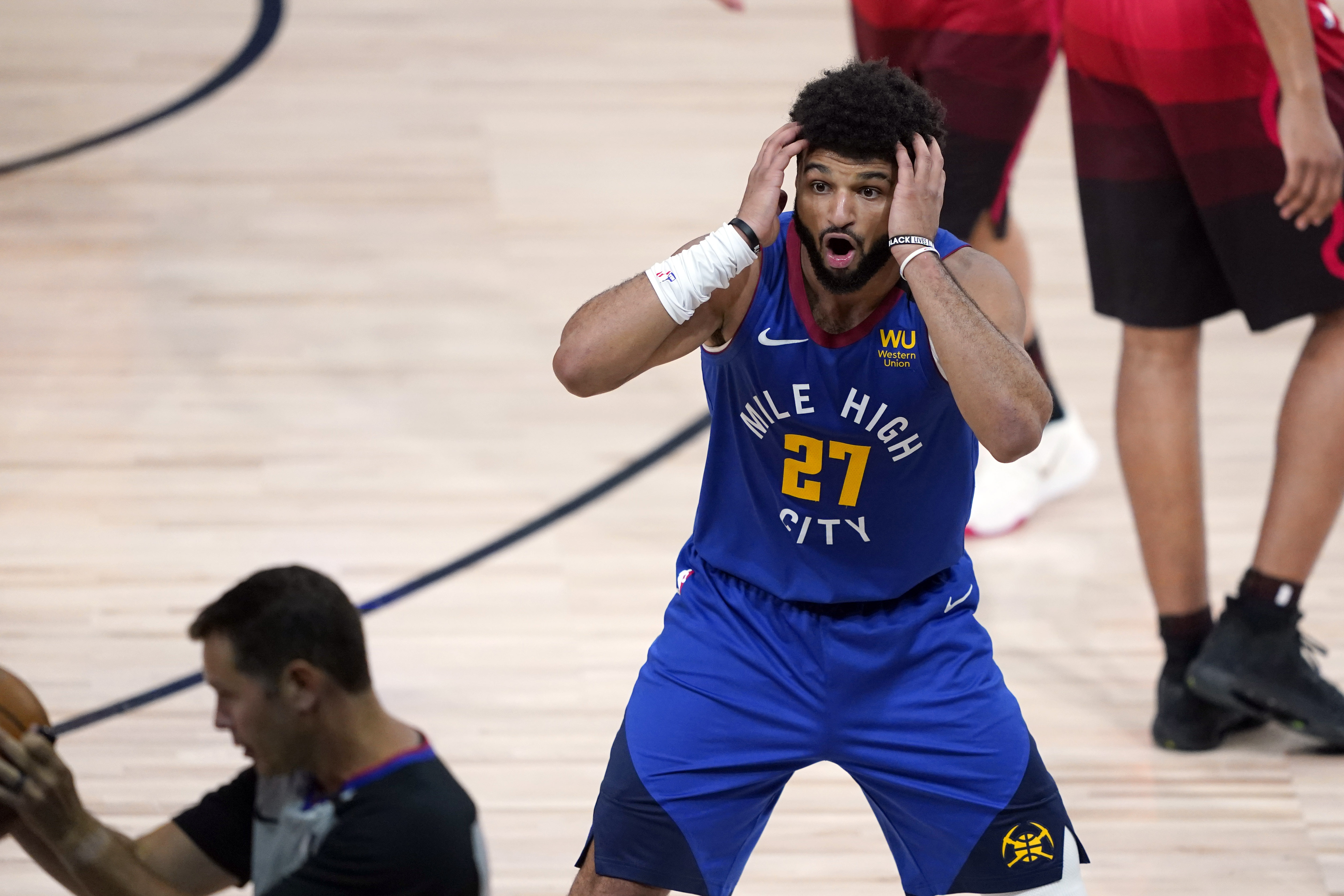 Denver Nuggets' Jamal Murray (27) reacts to a call in Sunday's game against the Jazz. (AP Photo/Ashley Landis, Pool)