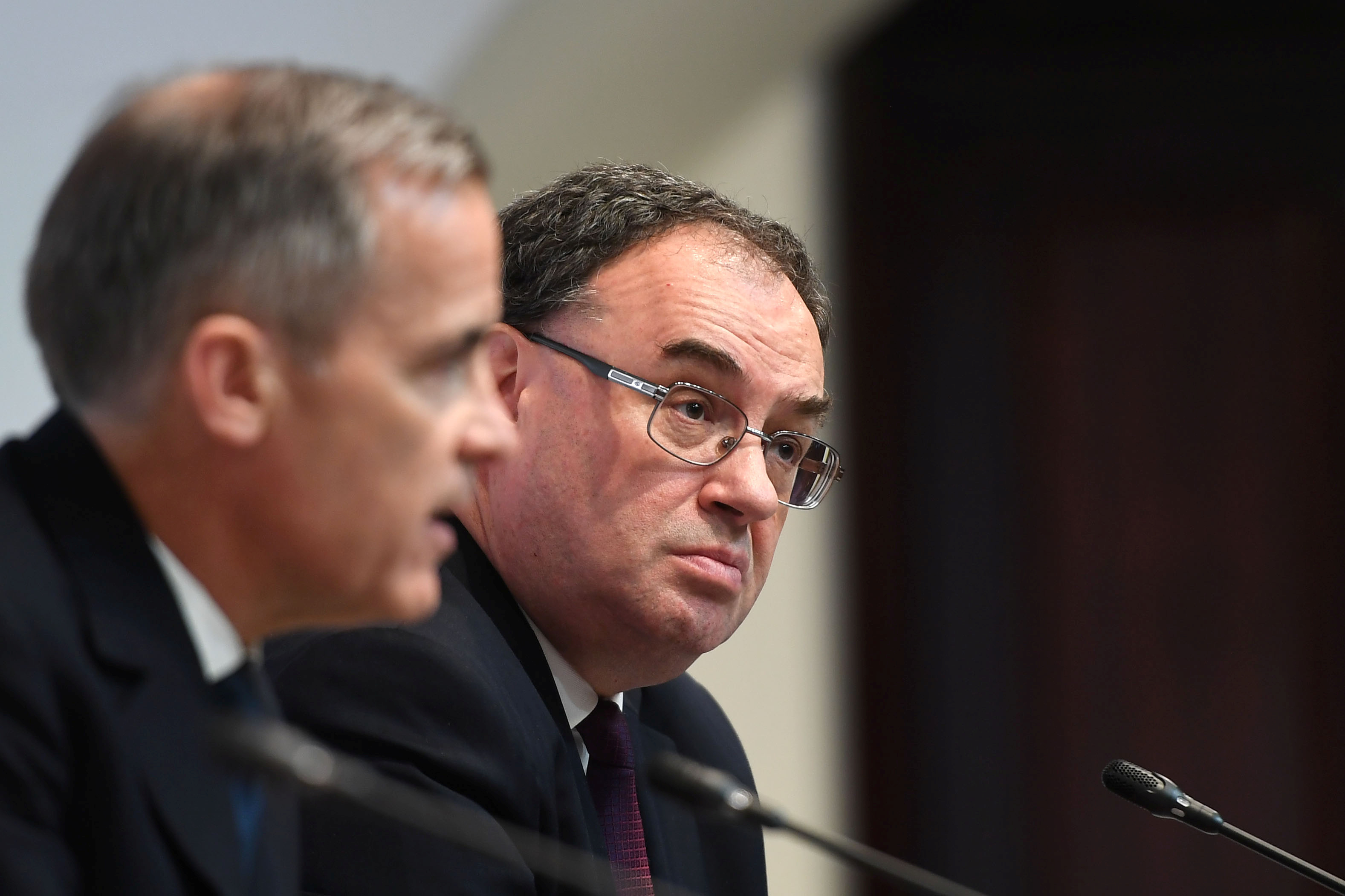 Mark Carney, Governor of Band of England and Andrew Bailey, Governor-designate of BOE, attend a news conference at Bank Of England in London, Britain March 11, 2020. Peter Summers/Pool via REUTERS