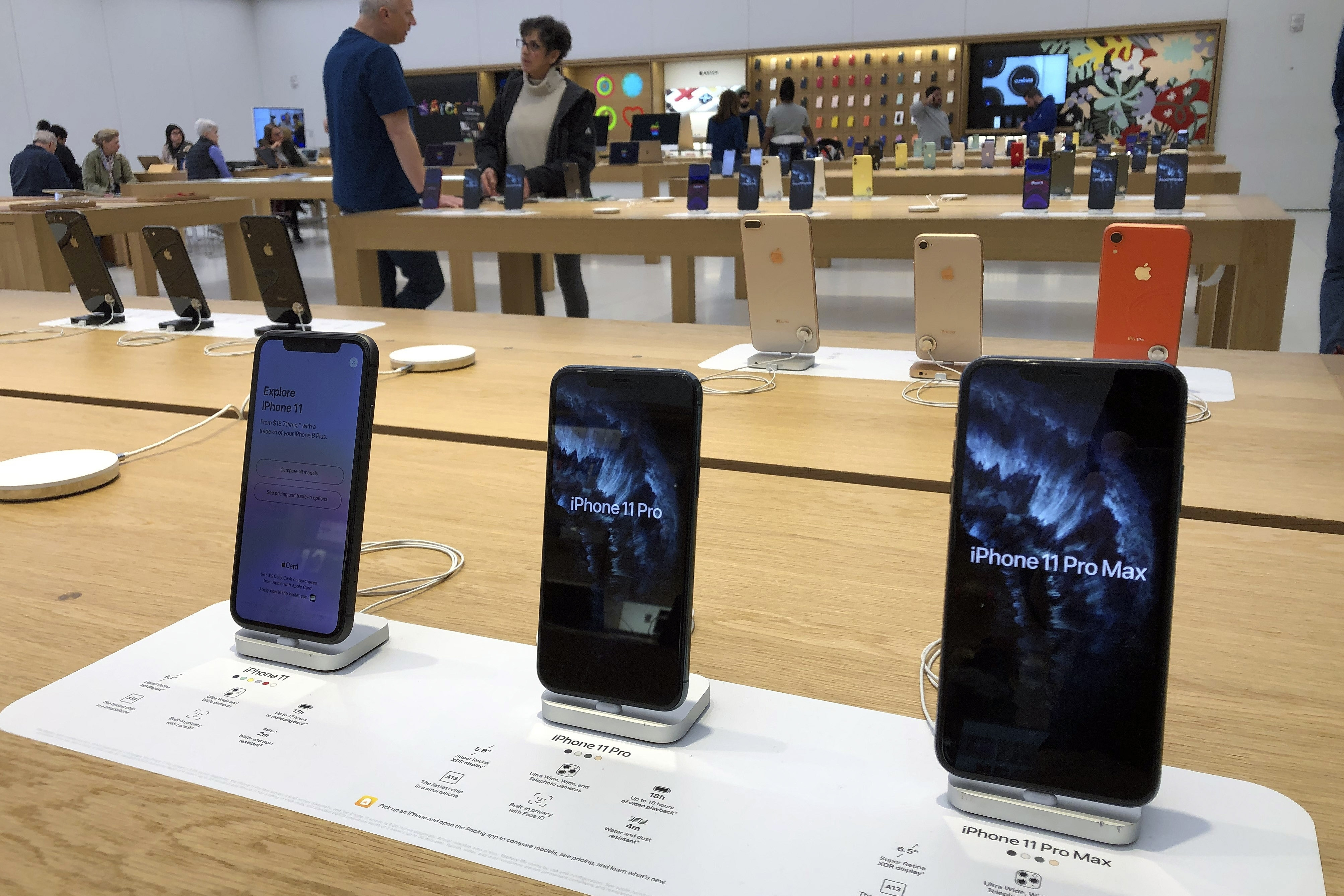 A selection of iPhones are displayed an Apple store Tuesday Jan. 28 2020 in suburban Boston. Apple reports financial earns on Tuesday
