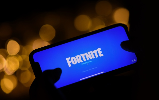 This illustration picture shows a person logging into Epic Games' Fortnite on their smartphone in Los Angeles on August 14, 2020. - Apple and Google on August 13, 2020 pulled video game sensation Fortnite from their mobile app shops after its maker Epic Games released an update that dodges revenue sharing with the tech giants. (Photo by Chris DELMAS / AFP) (Photo by CHRIS DELMAS/AFP via Getty Images)