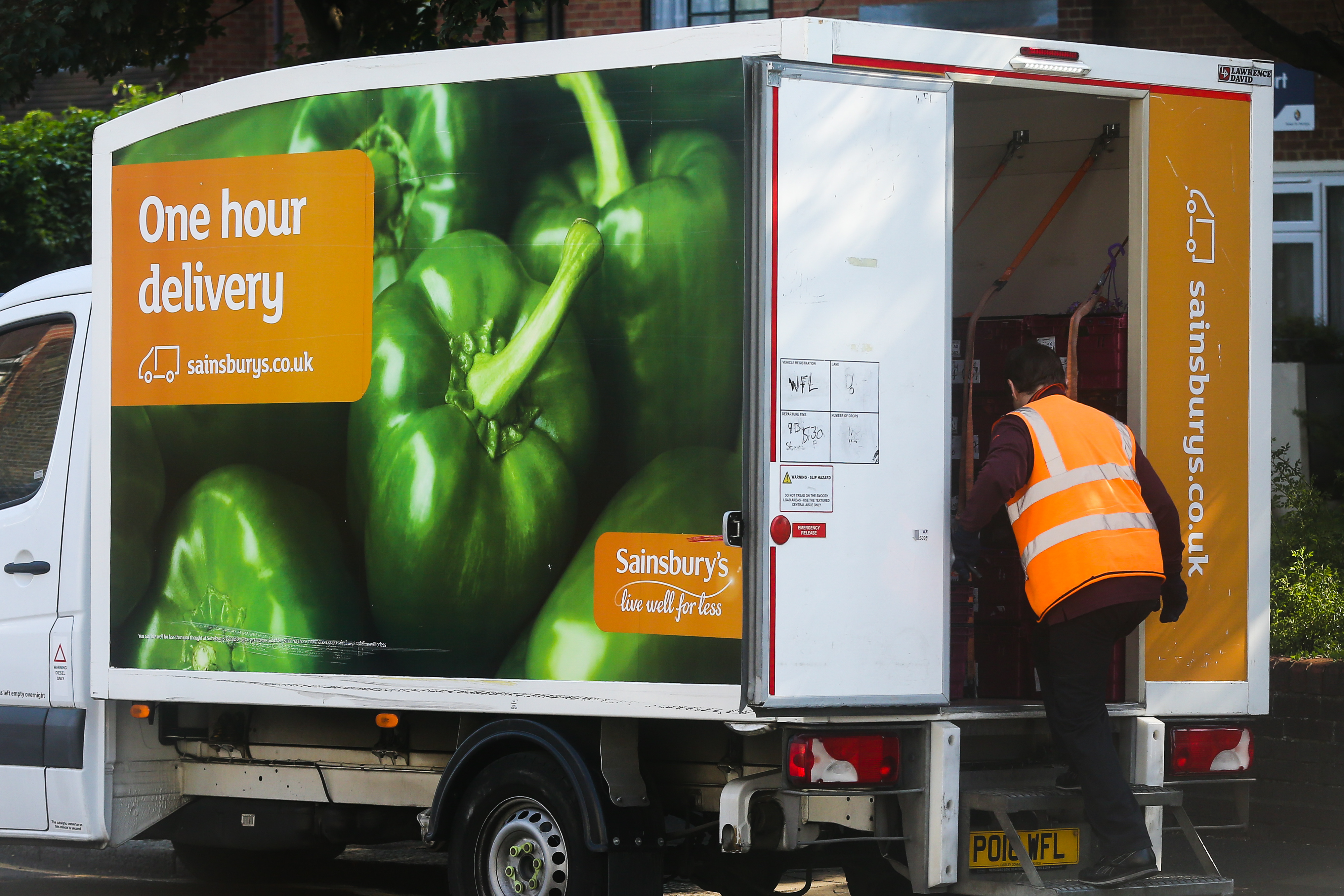 LONDON, UNITED KINGDOM - 2020/06/24: Delivery man enters a Sainsbury's delivery van as he prepares to deliver groceries purchased online from Sainsbury's supermarket. (Photo by Steve Taylor/SOPA Images/LightRocket via Getty Images)