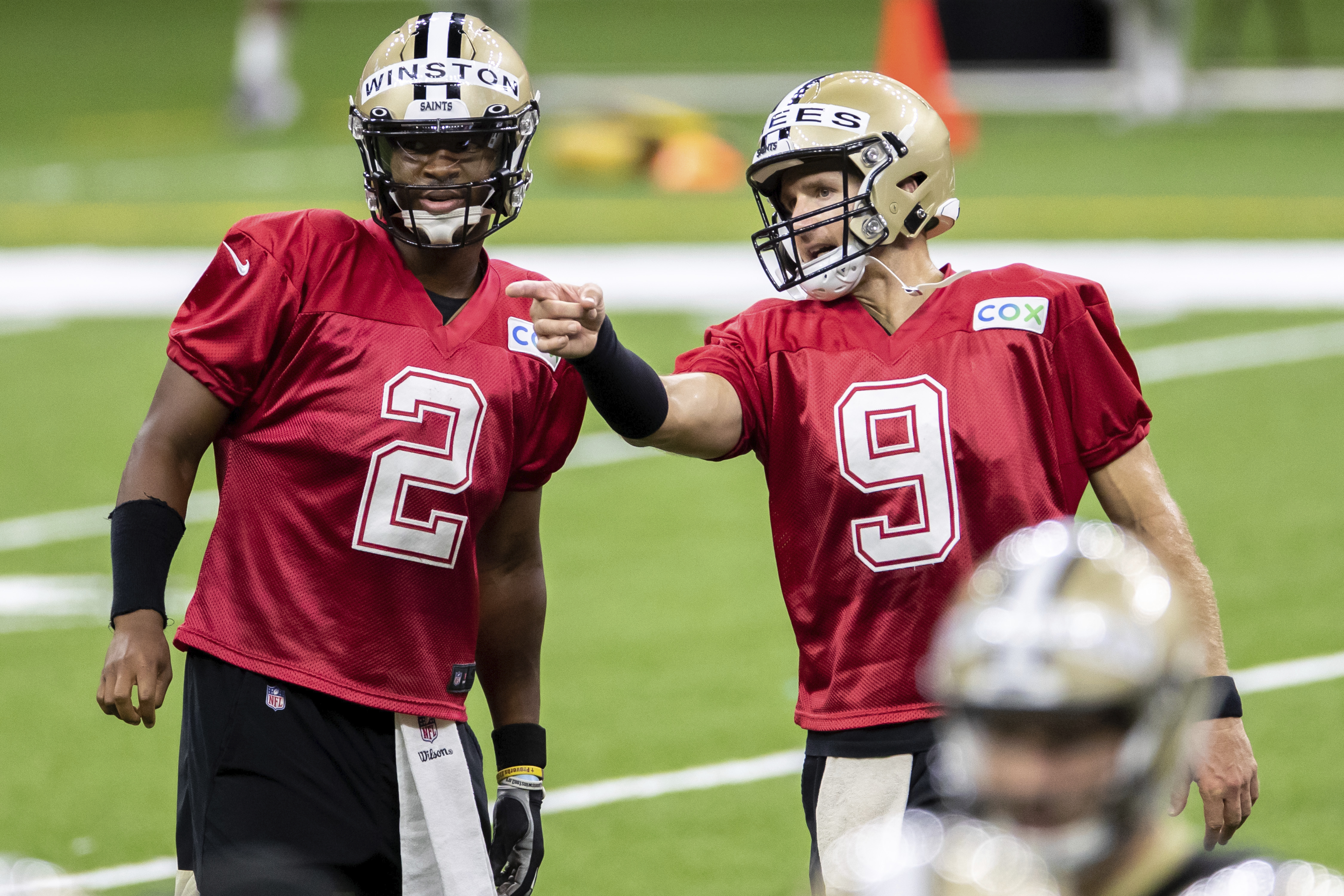 New Orleans Saints quarterback Drew Brees (9) talks with Jameis Winston (2) during a practice. (David Grunfeld/The Advocate via AP, Pool)