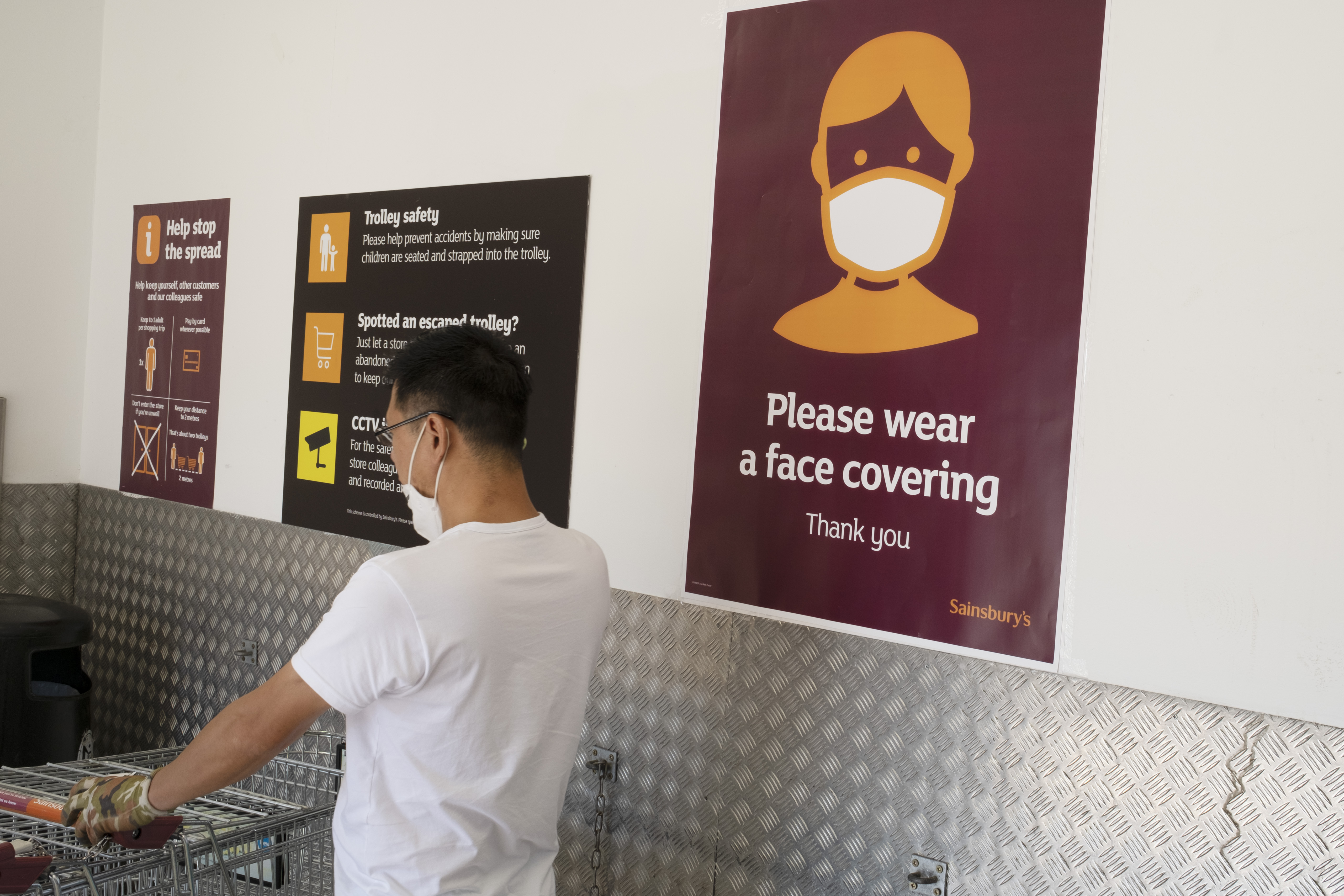 With most shops now open but with retail sales suffering due to the Coronavirus pandemic, shoppers wearing face maks at Sainsbury's supermarket, which became compulsory in shops on the 24th July, out shopping on Kings Heath High Street on 31st July 2020 in Birmingham, United Kingdom. Coronavirus or Covid-19 is a respiratory illness that has not previously been seen in humans. While much or Europe has been placed into lockdown, the UK government has put in place more stringent rules as part of their long term strategy, and in particular social distancing. (photo by Mike Kemp/In PIctures via Getty Images)