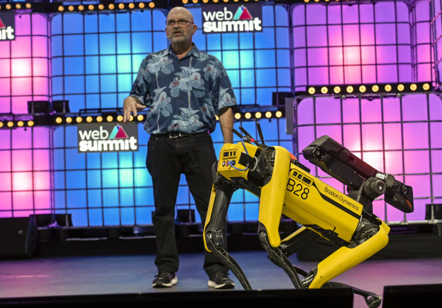 "LISBON, PORTUGAL - NOVEMBER 07: Marc Raibert, Founder & CEO, Boston Dynamics, speaks on ""Welcome to the future of mobile robots"" and demonstrate their capability onstage with Spot, one of them at Center Stage of Web Summit in Altice Arena on November 07, 2019 in Lisbon, Portugal. Web Summit is an annual technology conference which brings together a variety of technology companies to discuss the future of industry. This year's event runs from November 4- 7 and is expected to attract around 70,000 participants.  (Photo by Horacio Villalobos/Corbis via Getty Images)"