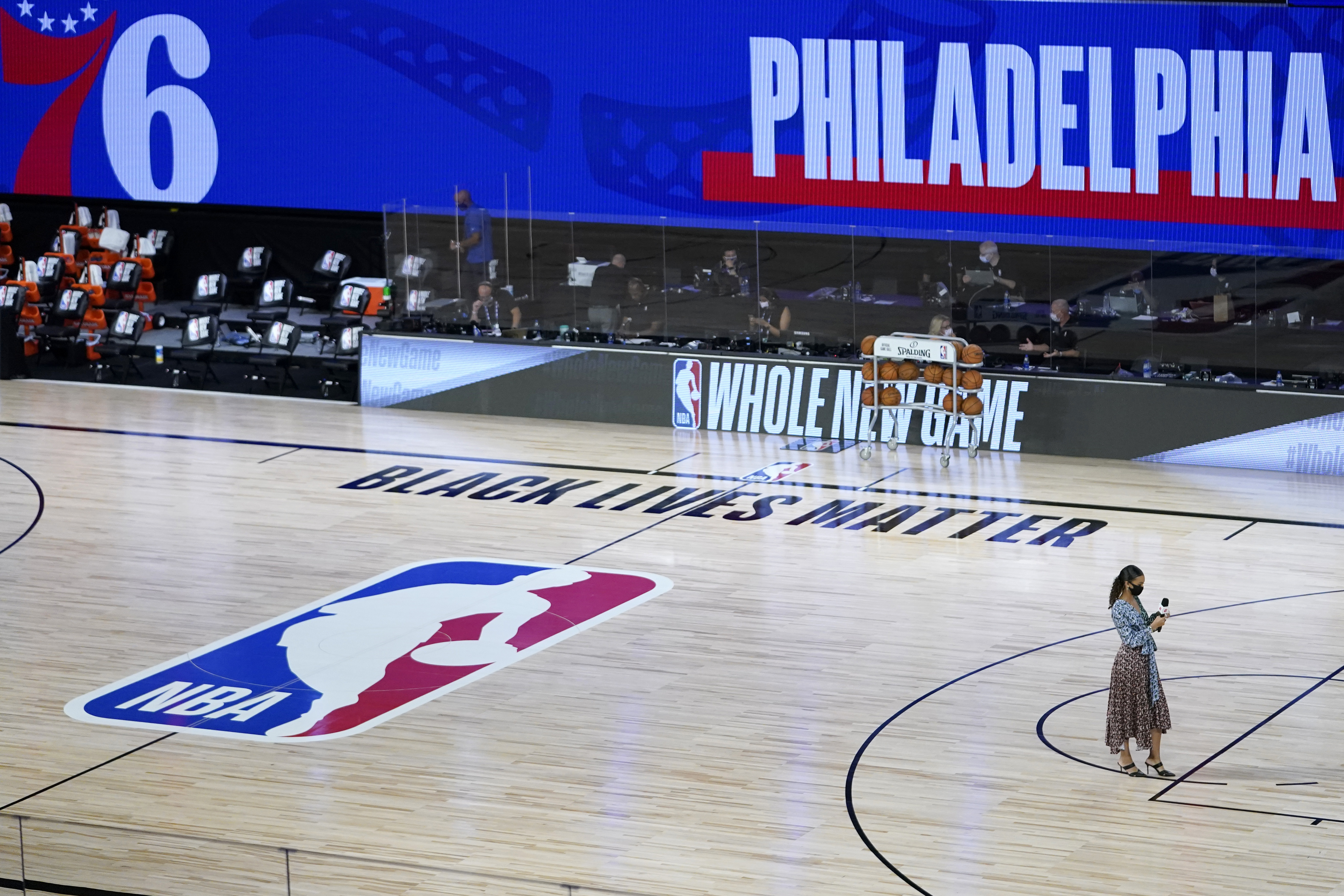 """Malika Andrews in the bottom right corner on the NBA court that says """"Black Lives Matter."""""""