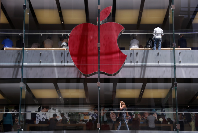 The Apple logo on display at the Sydney Apple Store is illuminated in red to mark World AIDS Day, in Sydney December 1, 2014. Apple stores across the world will display similar colored logos, with the Sydney store being the first. World AIDS Day is observed annually on December 1, which helps to raise awareness about AIDS and the spread of HIV.      REUTERS/David Gray      (AUSTRALIA - Tags: SOCIETY BUSINESS LOGO TPX IMAGES OF THE DAY) - GM1EAC10RW201