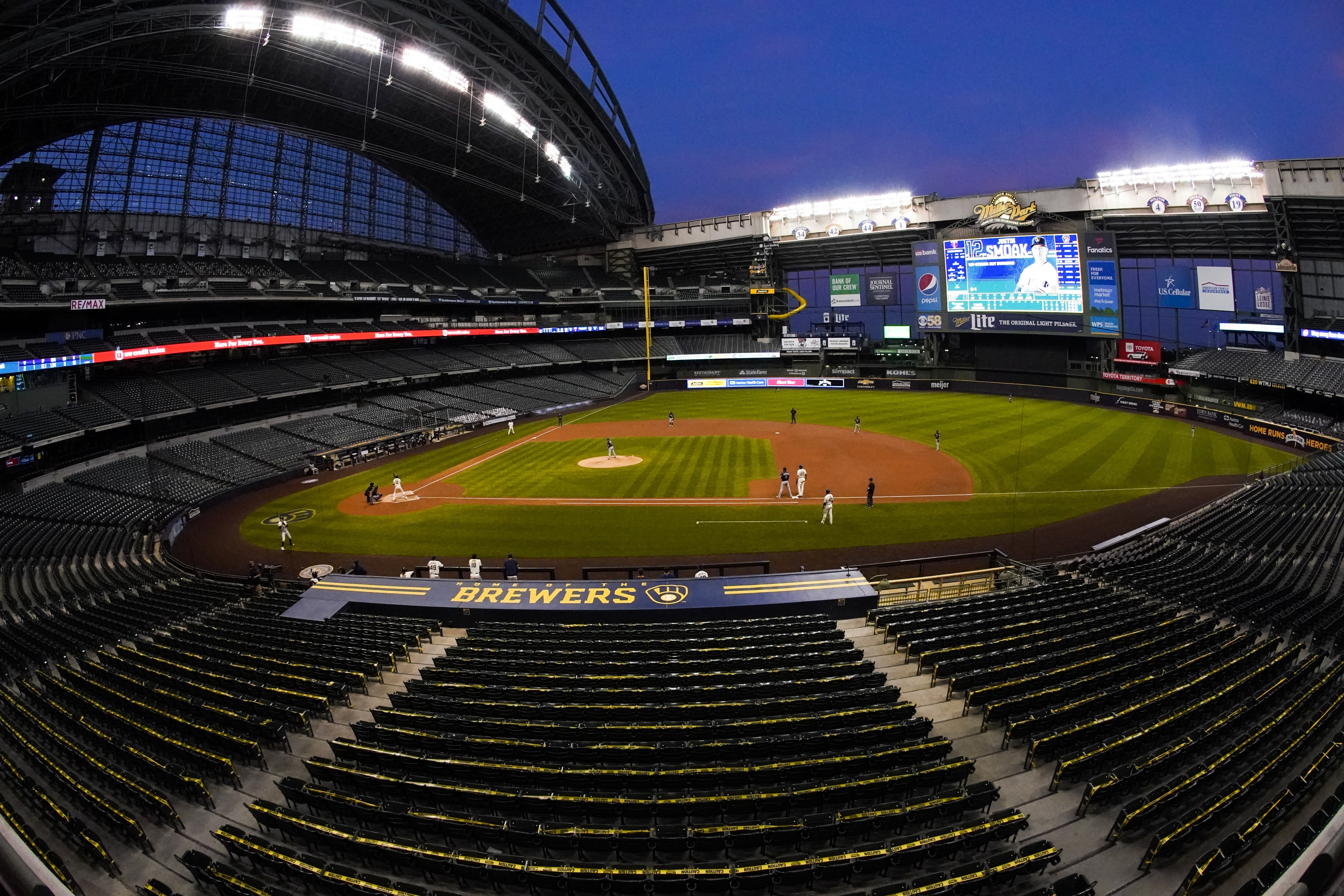 Miller Park at night with empty seats.