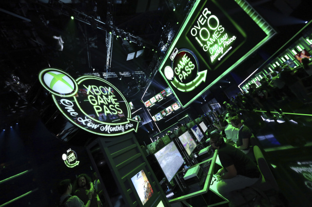 Gamers interact with newly-announced games, including some of the 14 new titles coming to Xbox Game Pass, at Xbox E3 2018 Showcase in Los Angeles on Sunday, June 10, 2018. (Photo by Casey Rodgers/Invision for Microsoft/AP Images)